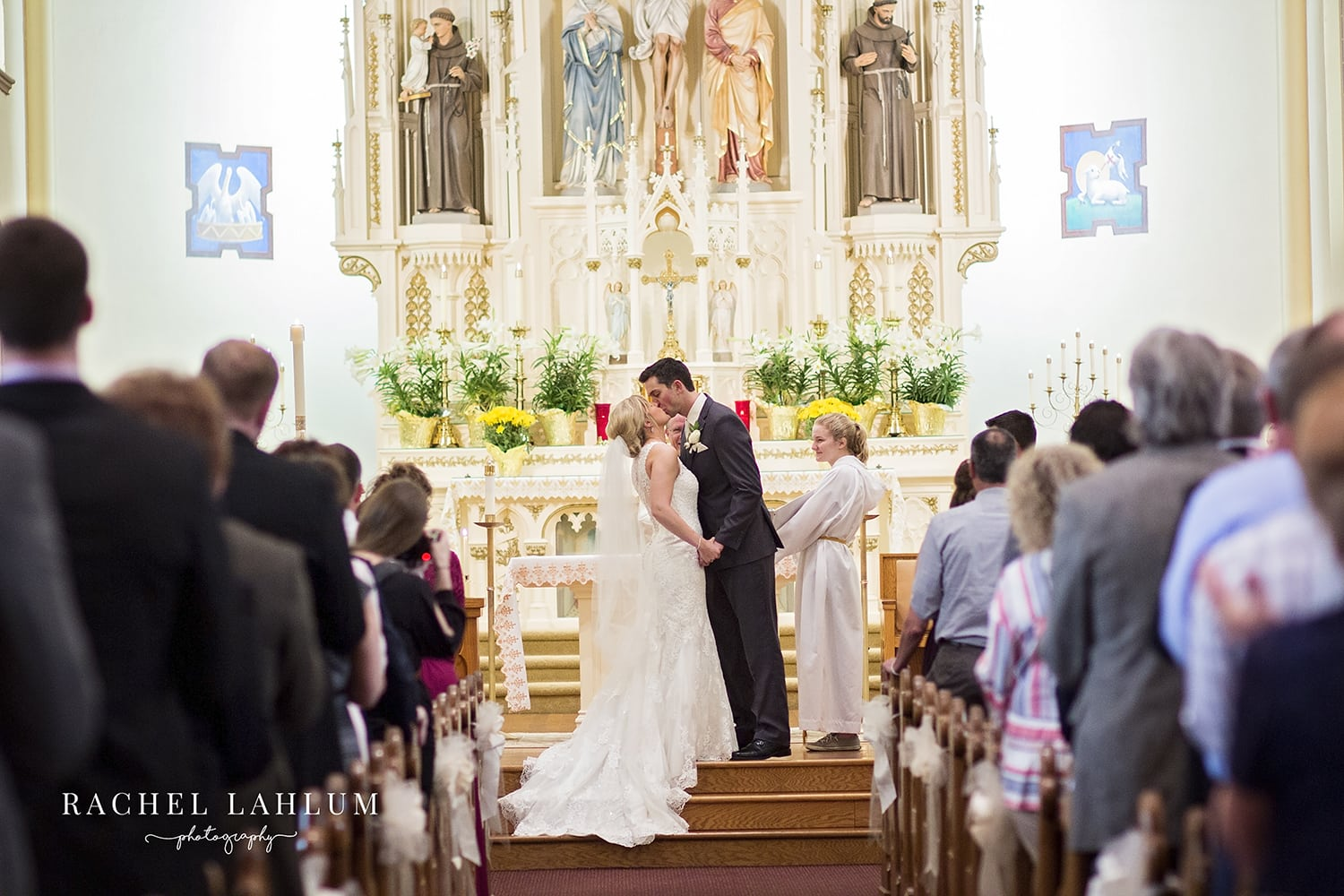 Bride and groom kiss at their wedding ceremony at Guardian Angels Catholic Church in Chaska, MN