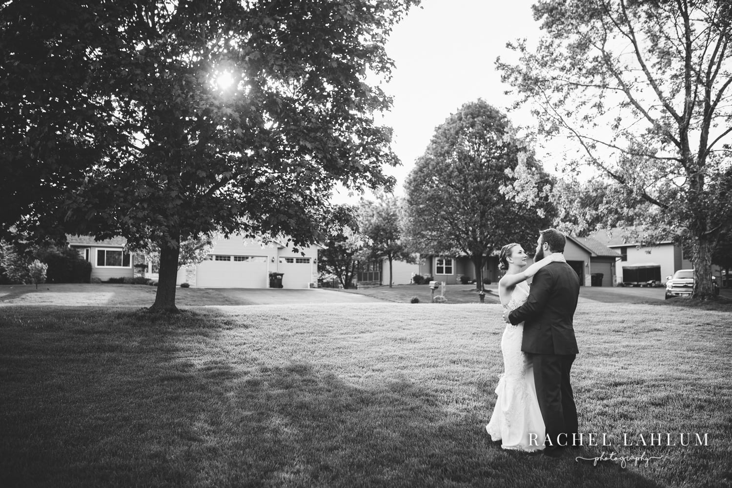 Black and white photo of bride and groom first dance - micro backyard wedding Minneapolis, MN