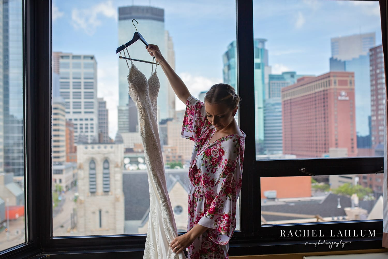 Bride getting ready in Millennium Hotel suite, Downtown Minneapolis