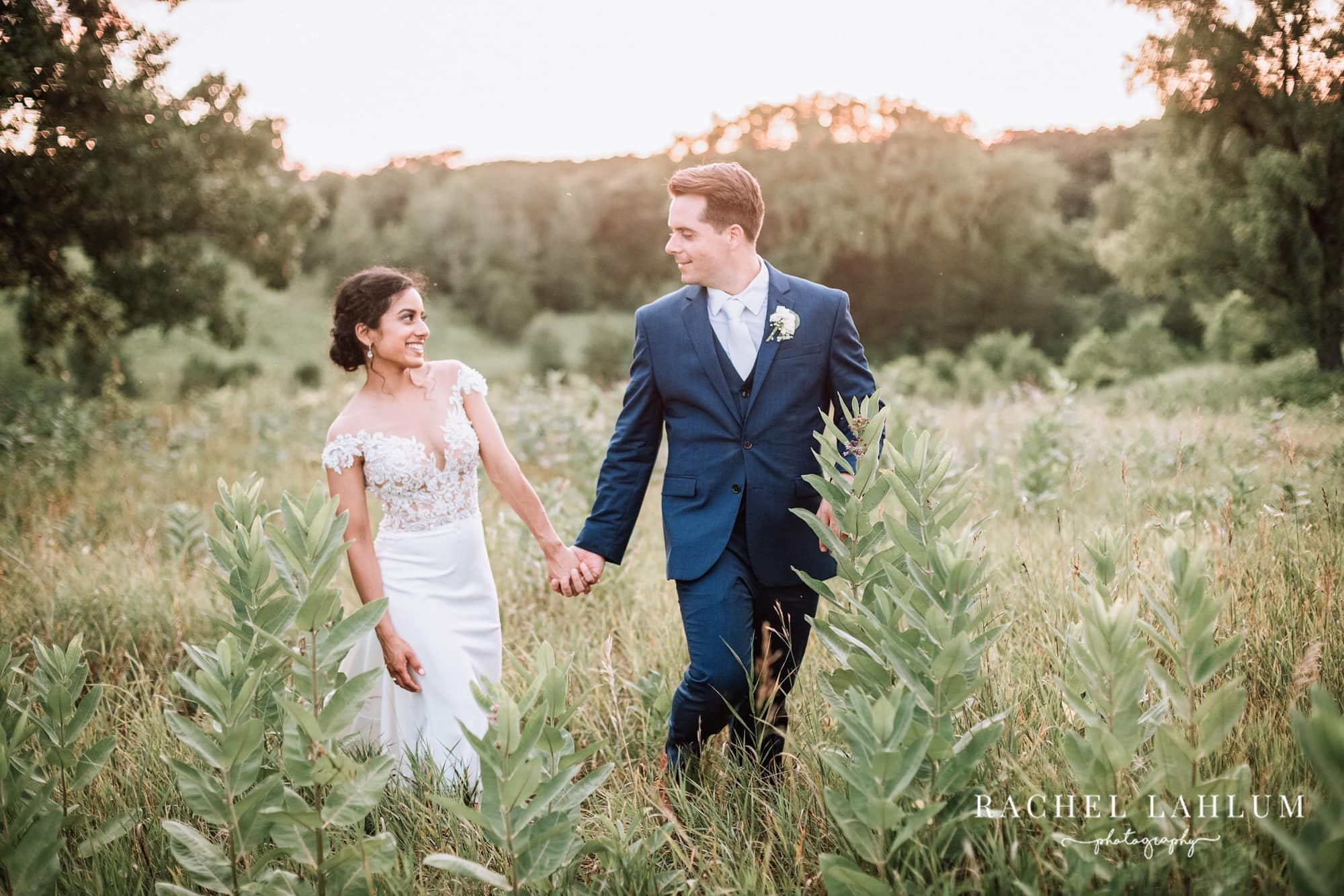Bride and Groom frolick through a field at Almquist Farm.
