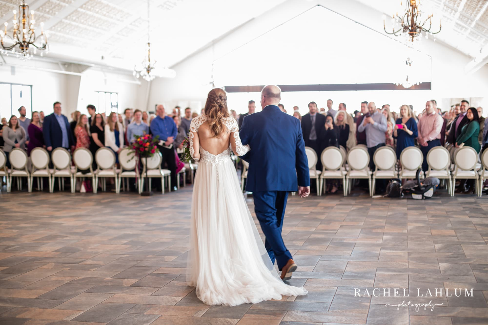 Jessa is walked down the aisle by her father at Bavaria Downs.