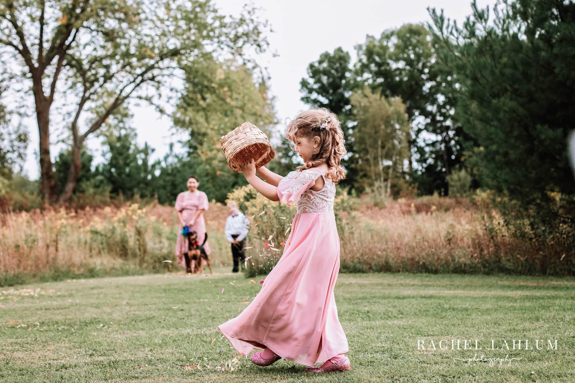 Flower girl empties her basket as she walks down the aisle.