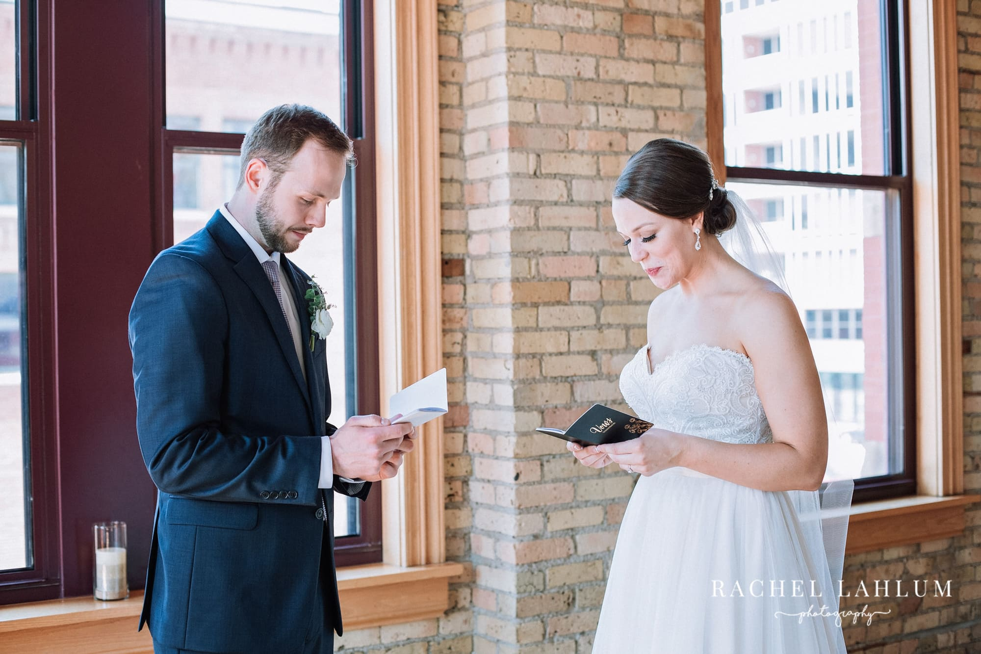 Bride and groom read notes they've exchanged.