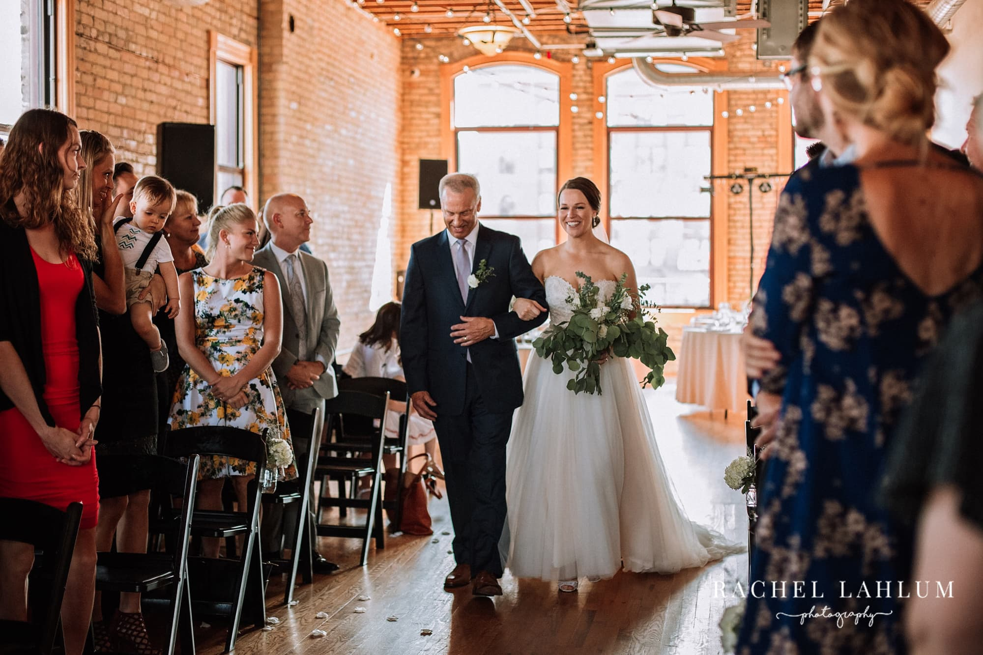 Father walks bride down the aisle for wedding at Day Block Event Center in Minneapolis.