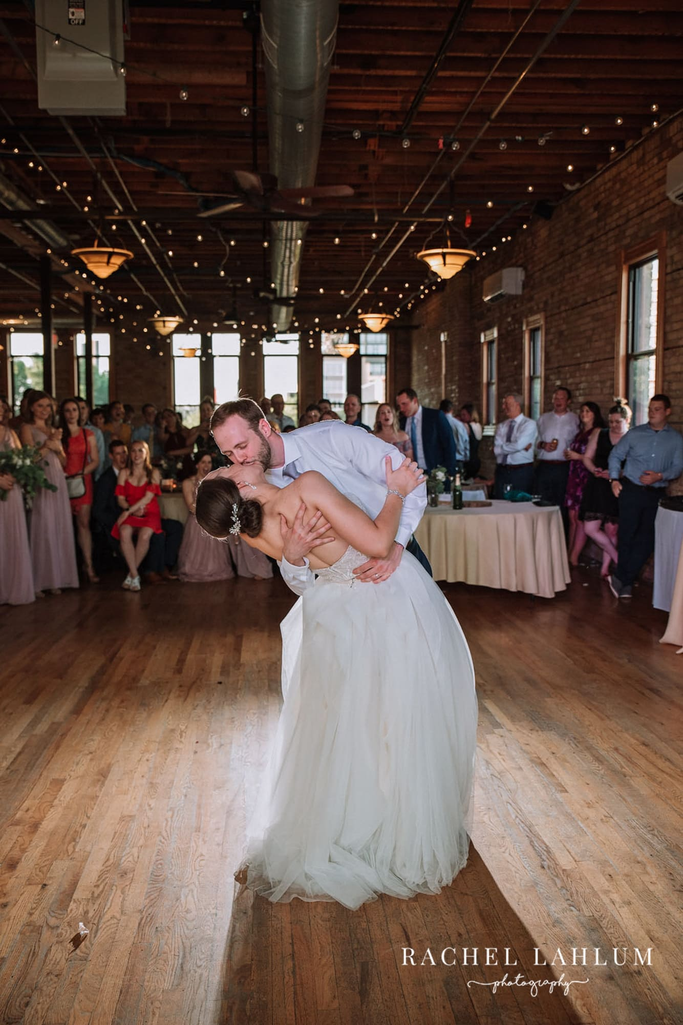 Groom dips and kisses bride at Minneapolis Wedding.