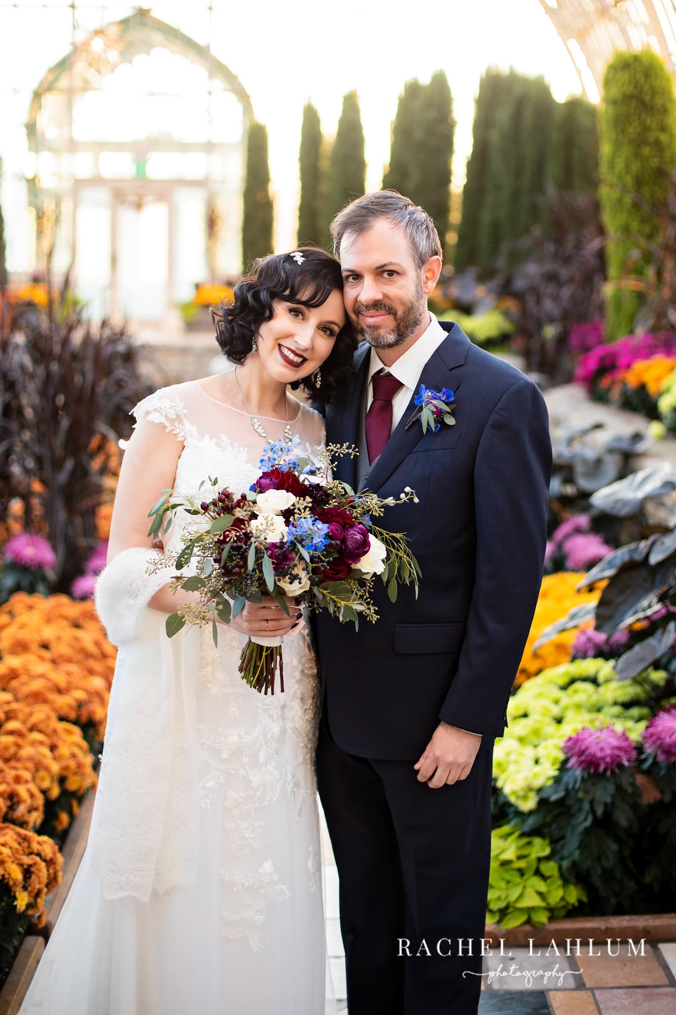 Portrait of bride and groom at Como Conservatory in Saint Paul, Minnesota.