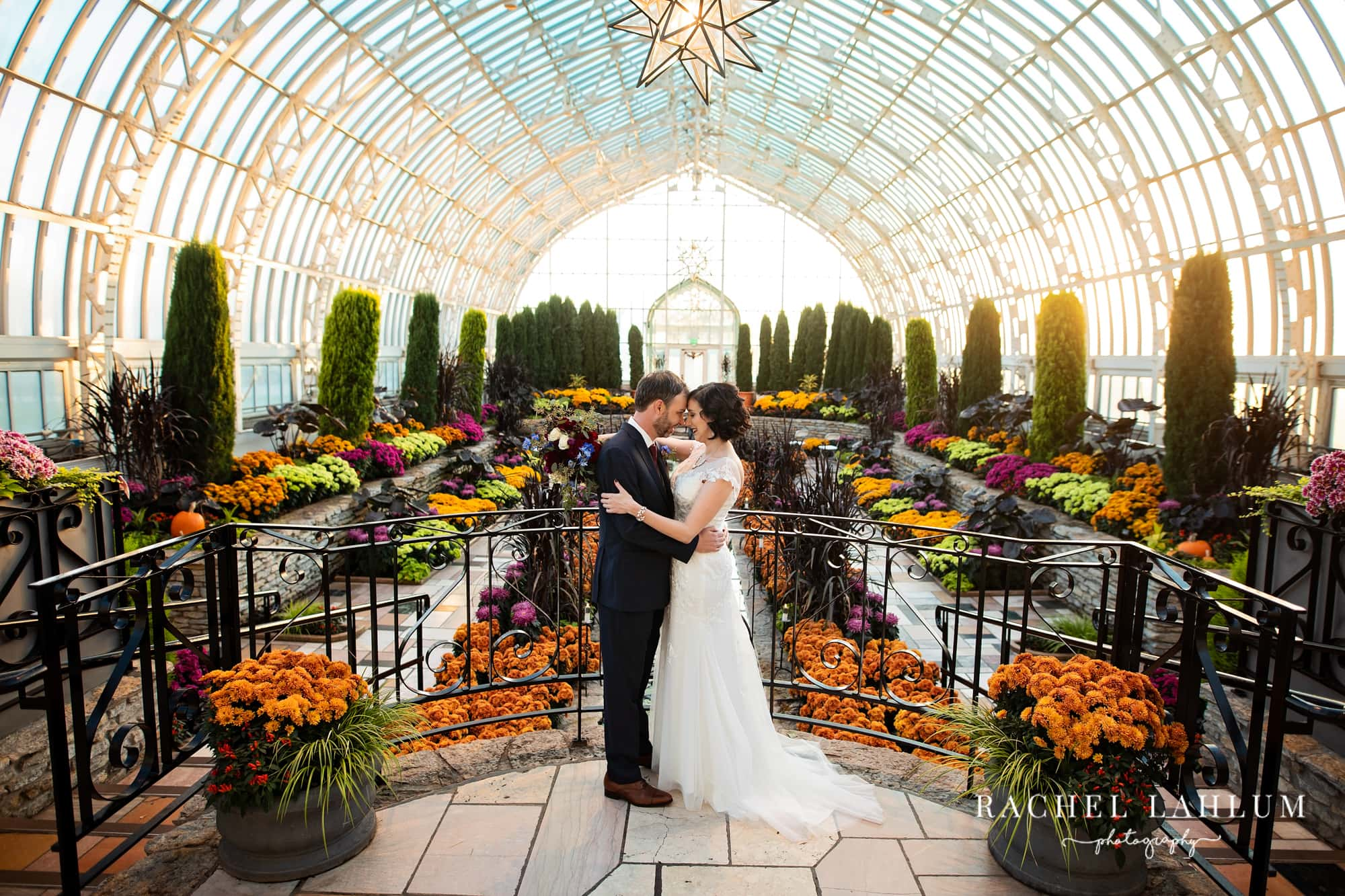 Bride and groom embracing on the upper landing in the Sunken Garden.