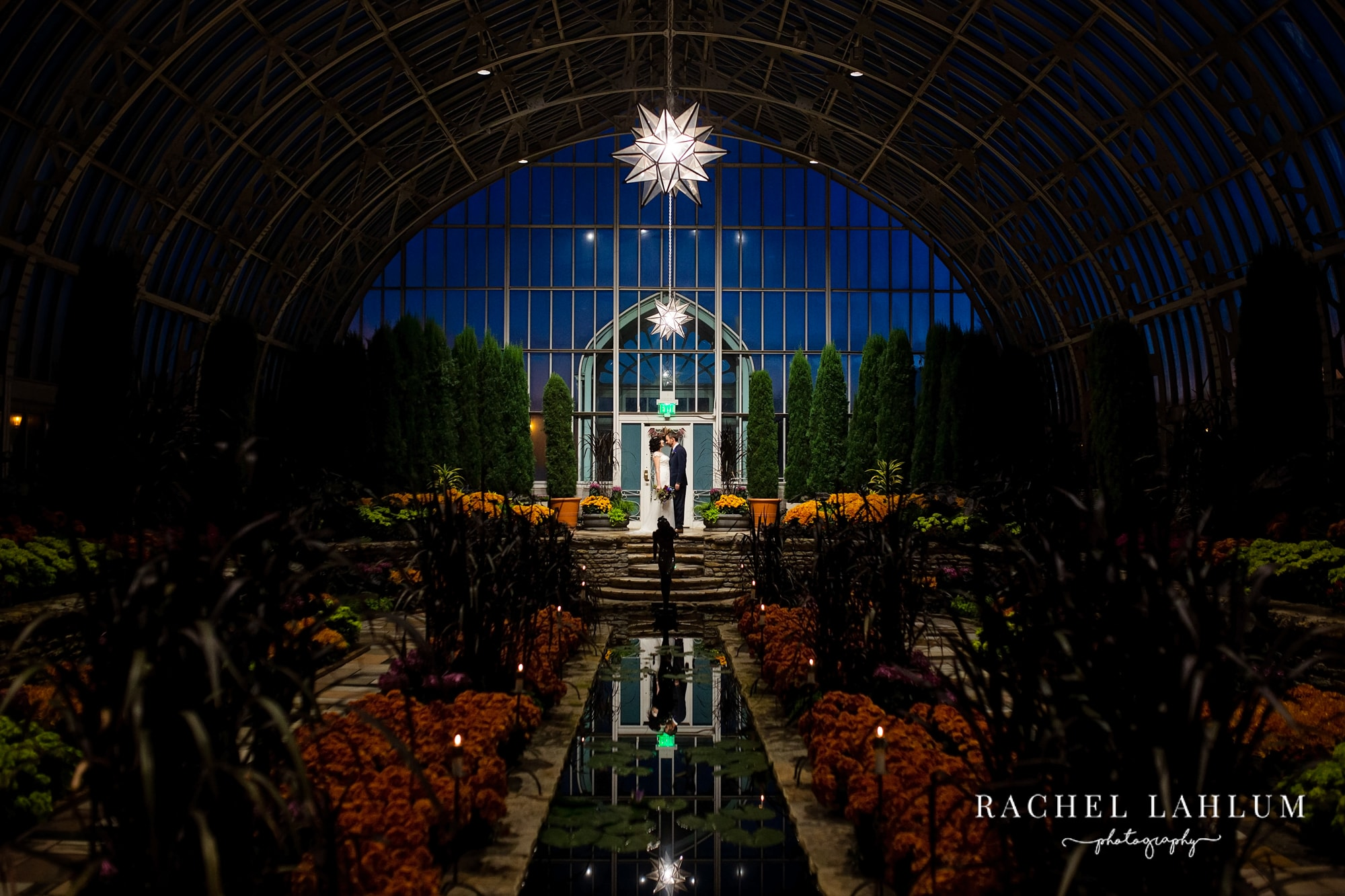 Night-time photos of wedding couple at Como Conservatory.