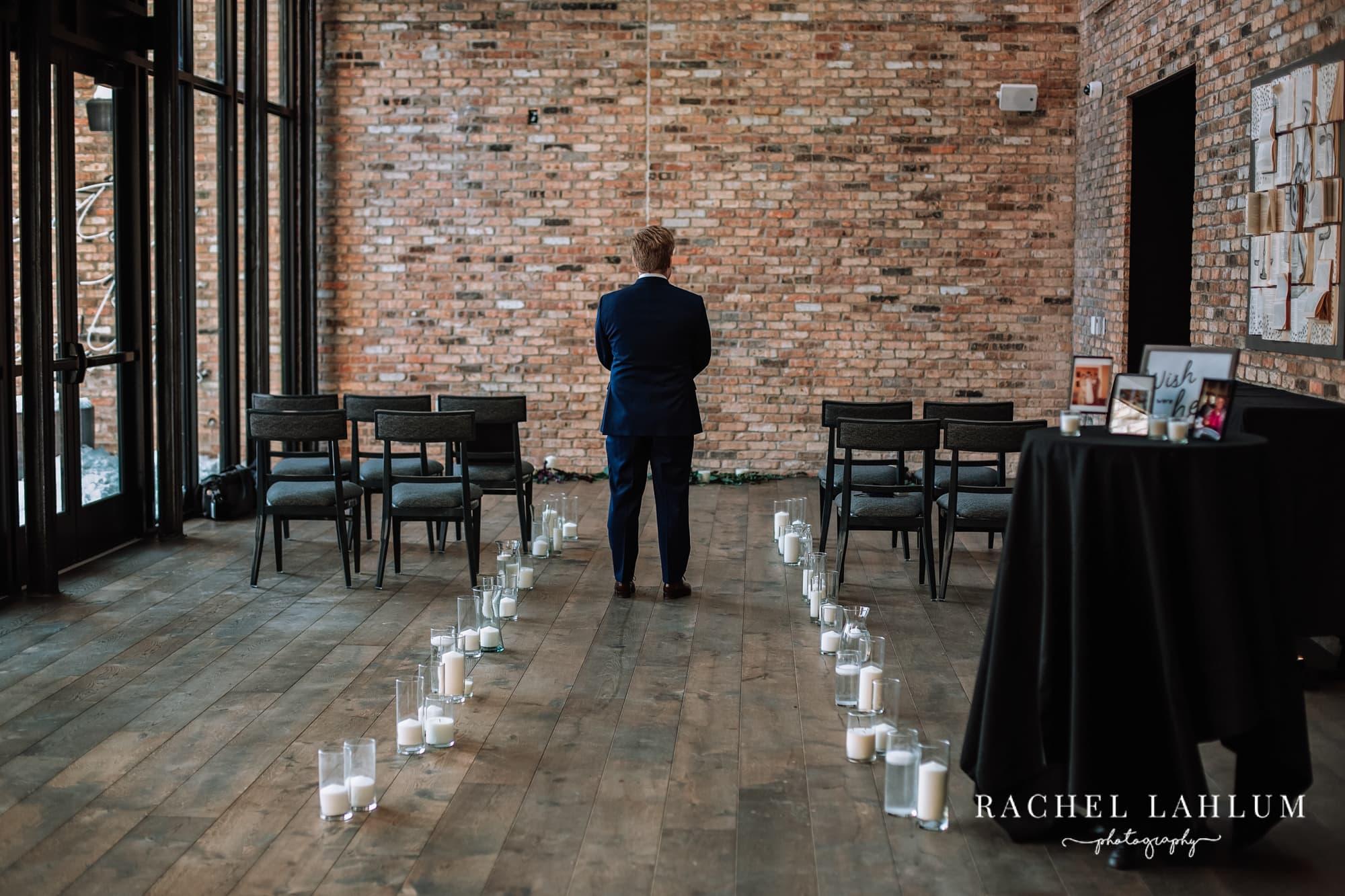 Groom awaits bride for first-look wedding photos.