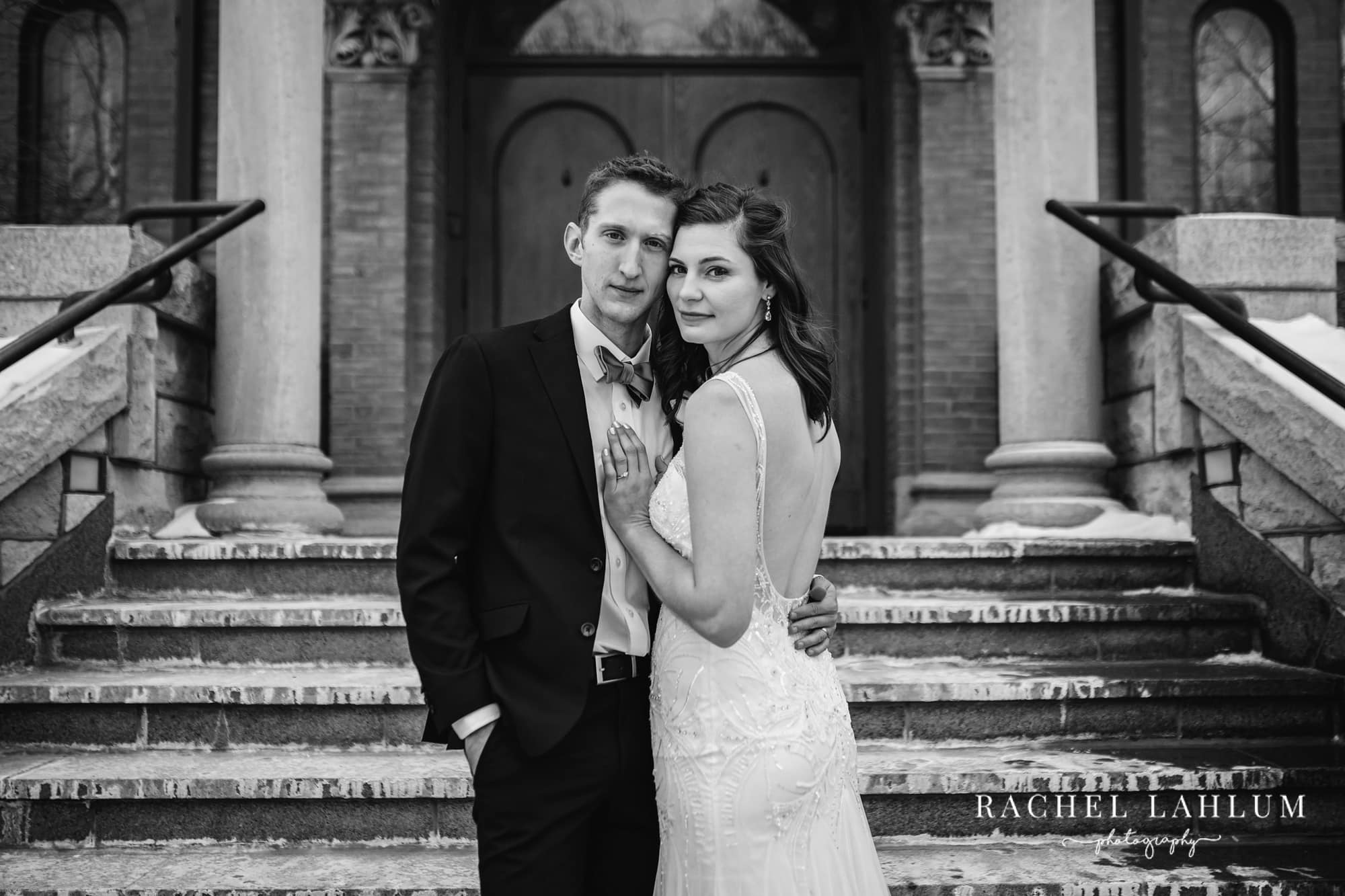 Bride and groom pose for a wedding portrait in front of St. Mary's Orthodox Cathedral in Northeast Minneapolis.