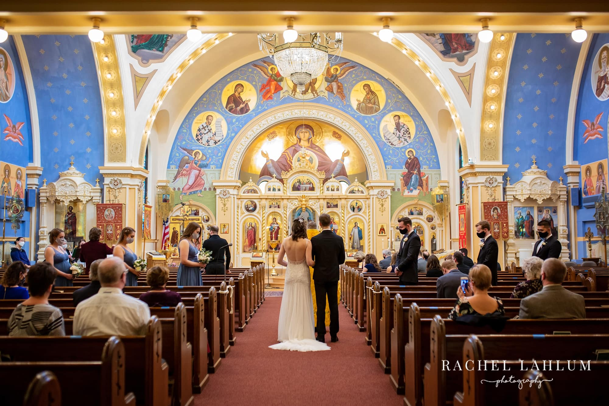 Bride and groom walk down the aisle at St. Mary's Orthodox Cathedral in Northeast Minneapolis.
