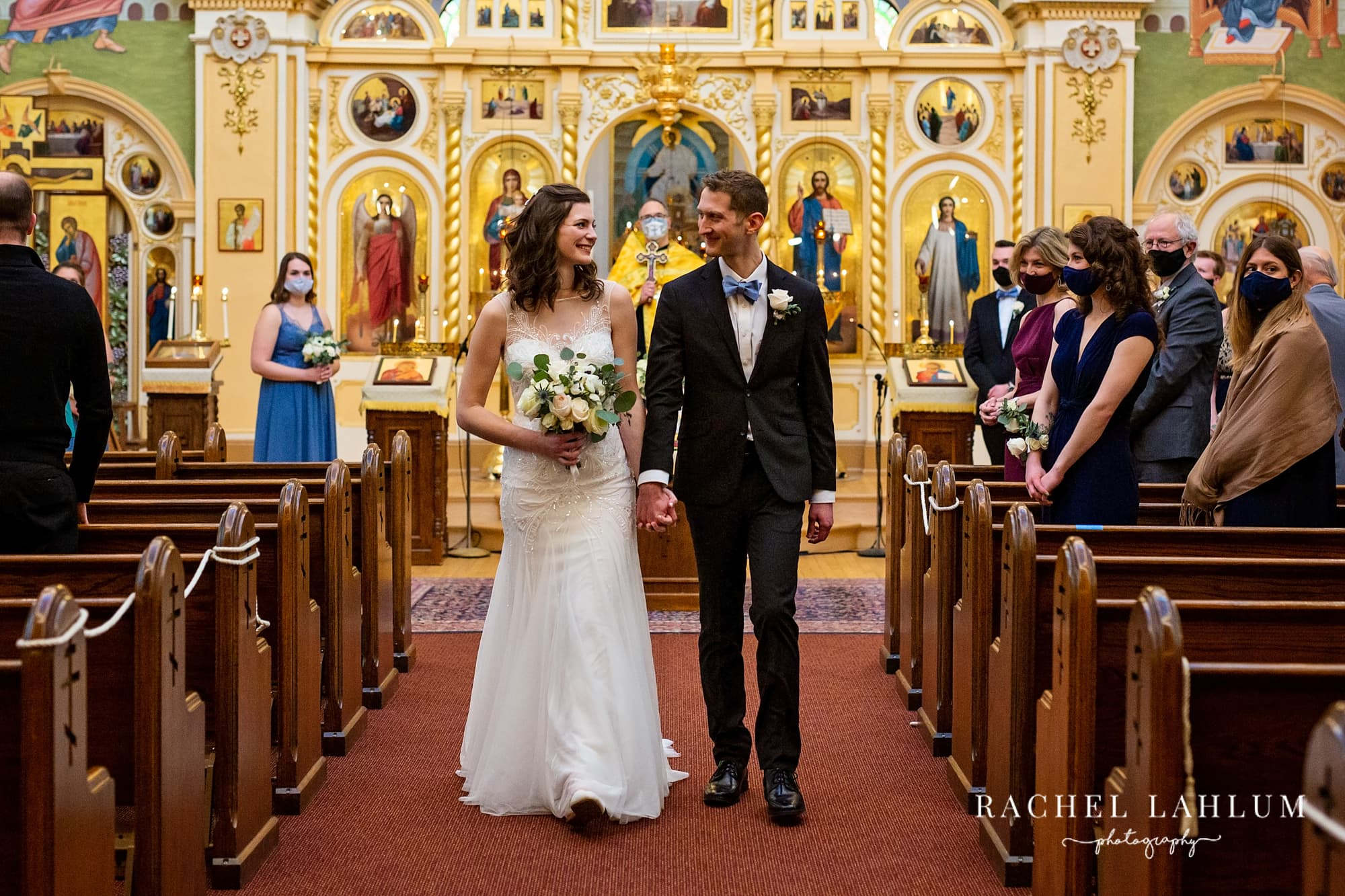Bride and groom walk down the aisle after exchanging vows in St. Mary's Orthodox Cathedral.