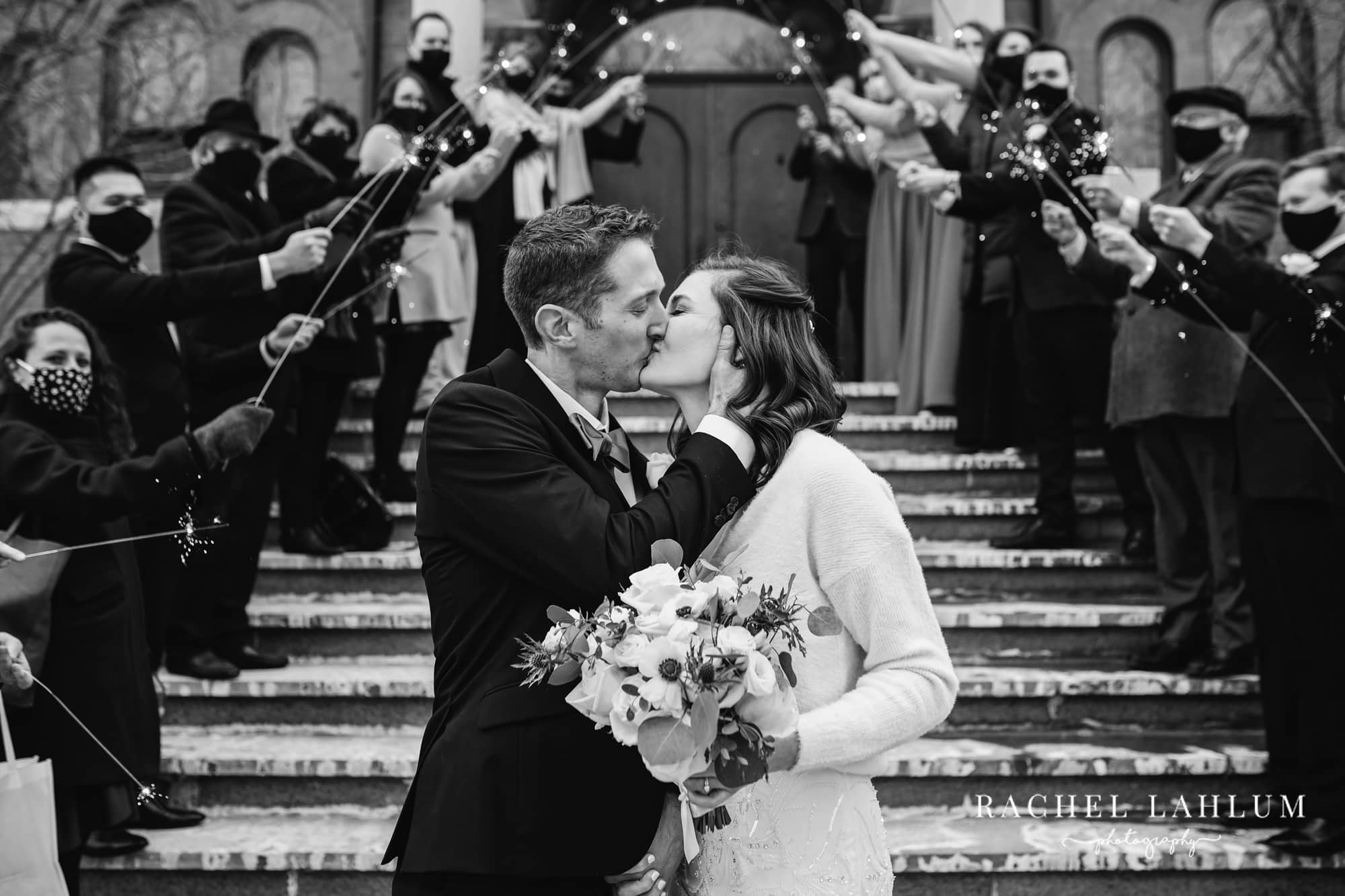 Bride and groom kiss after Northeast Minneapolis wedding at St. Mary's Orthodox Cathedral.