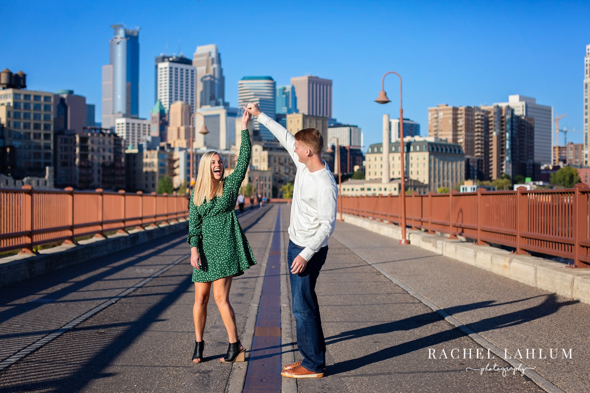 Morning engagement session on the Stone Arch Bridge in Downtown Minneapolis, MN.