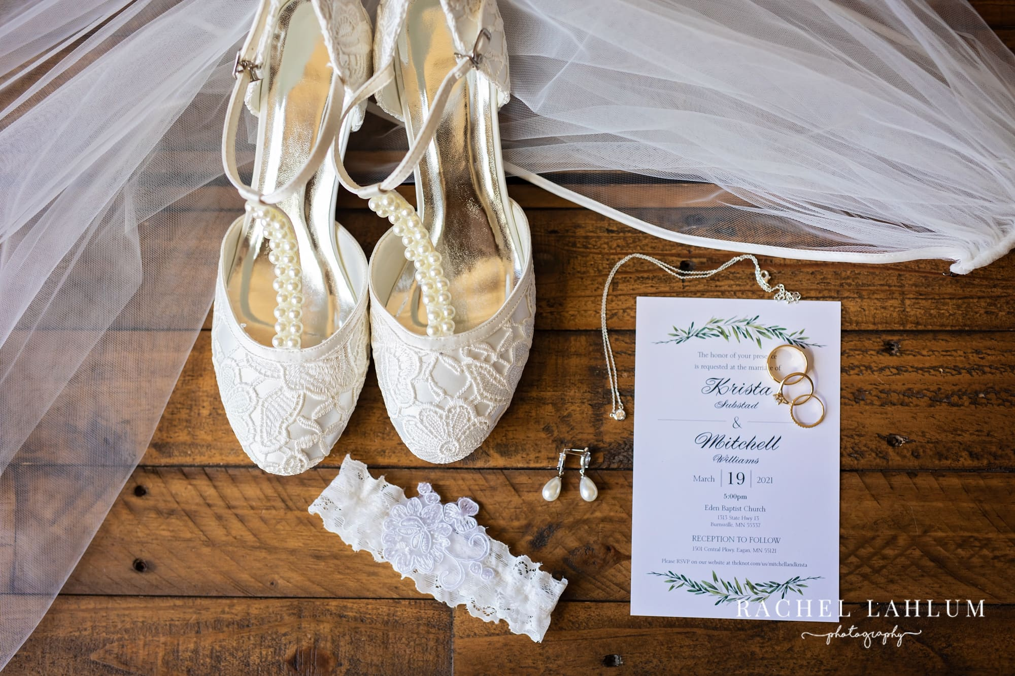 Close-up photo of wedding accessories, save-the-date, and wedding rings for Burnsville, Minnesota wedding.