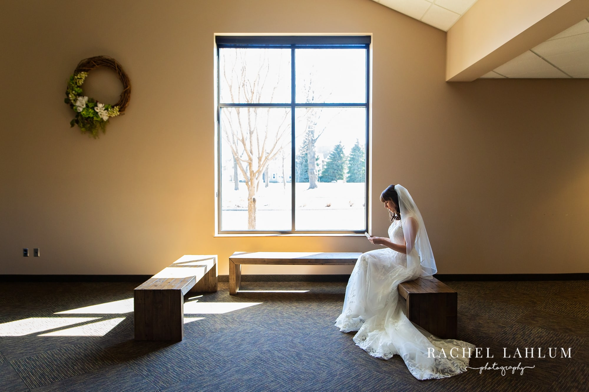 Bride reads letter from groom before wedding ceremony.