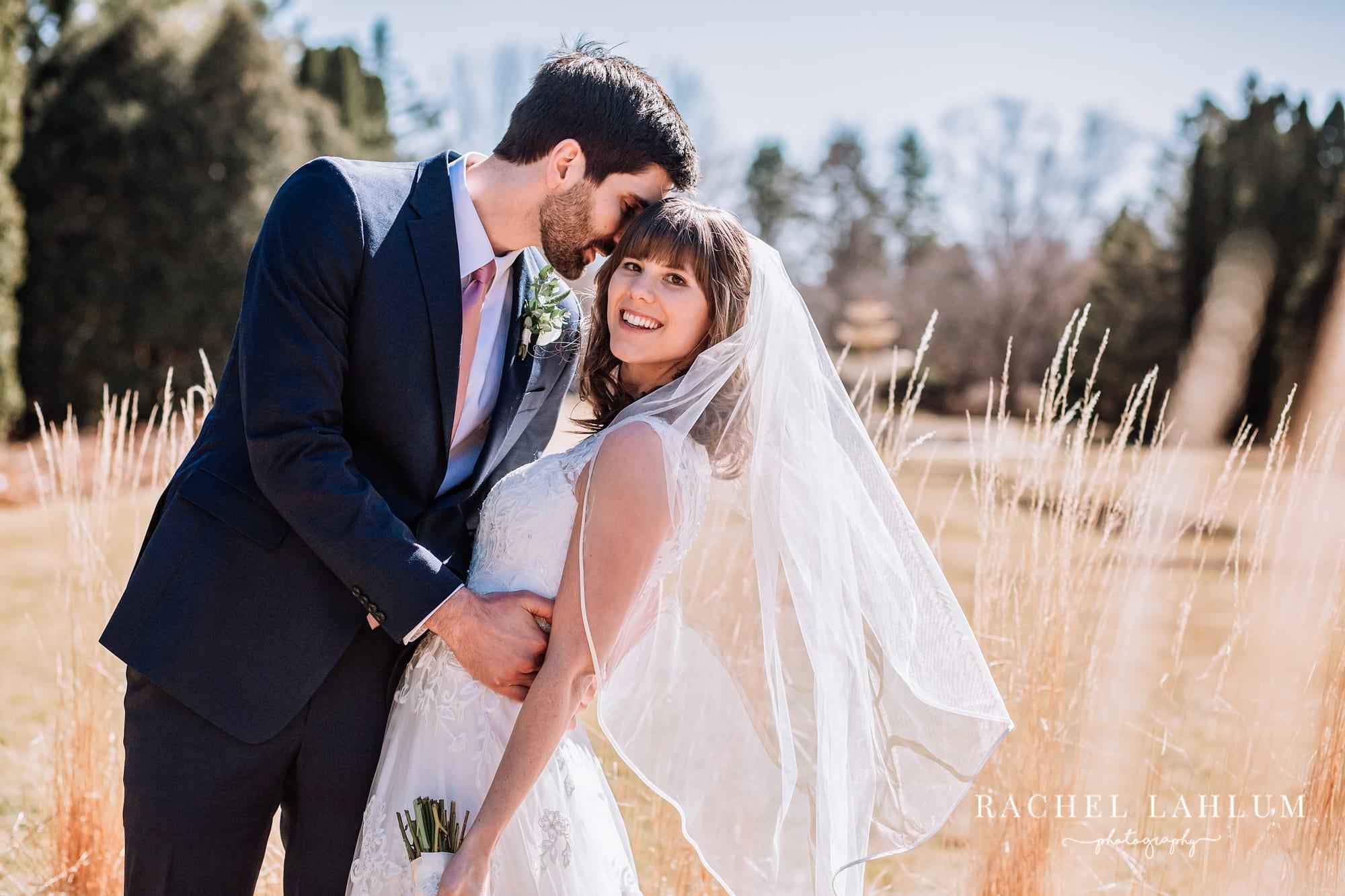Groom dips bride in portrait at Mendakota Country Club.