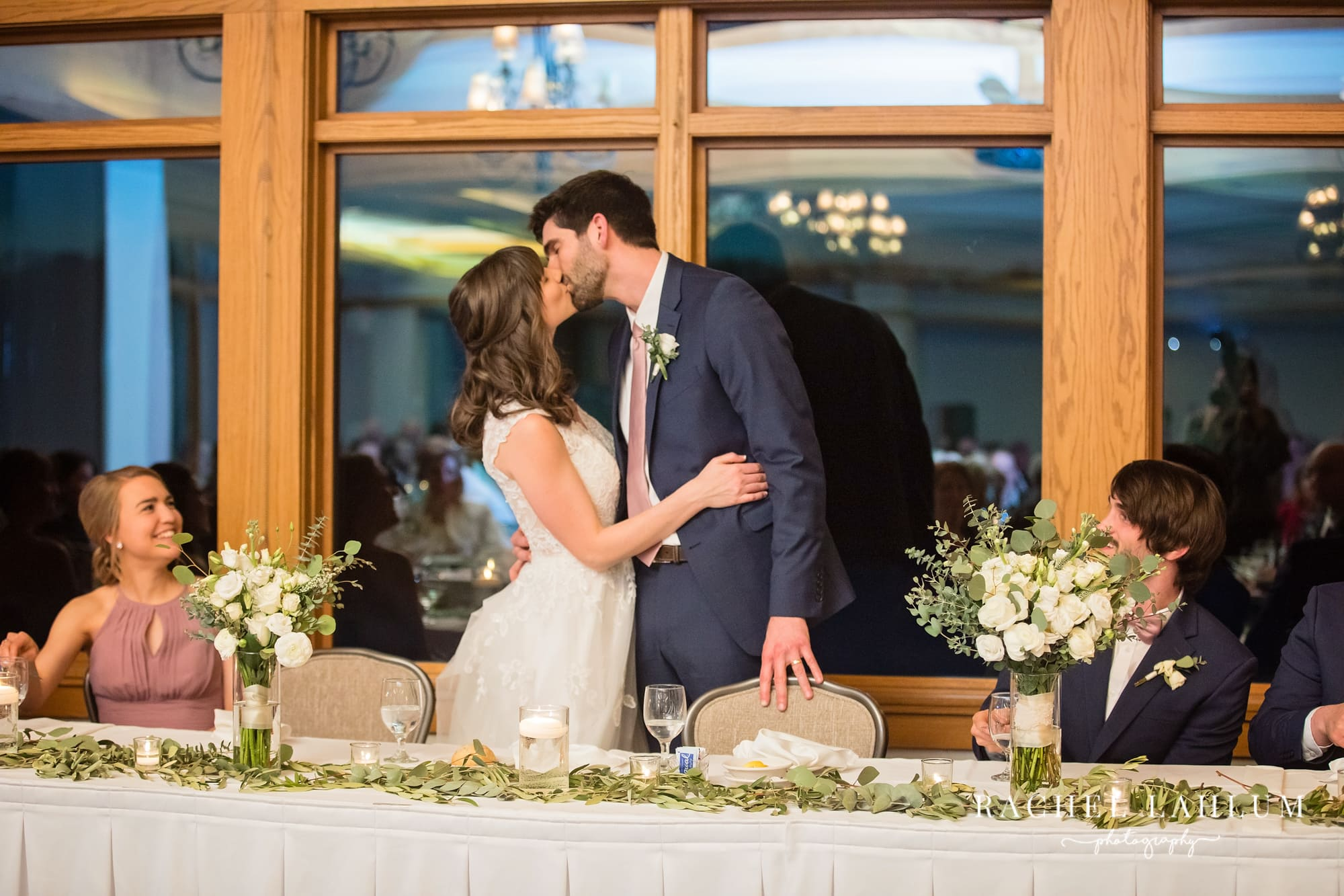 Bride and groom kiss during reception at Mendakota Country Club in St. Paul Minnesota.