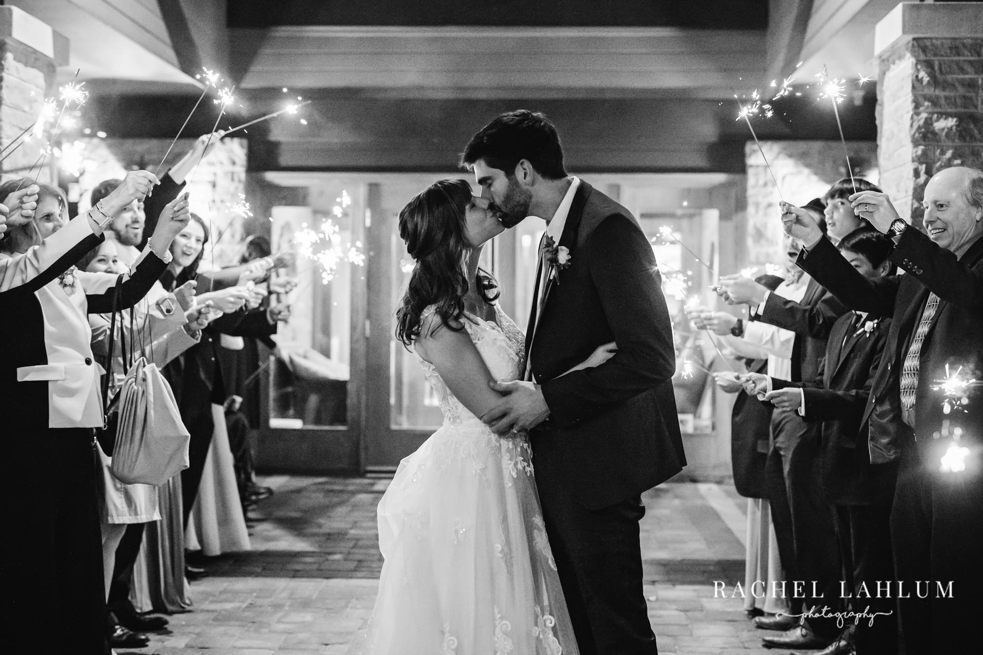 Portrait of bride and groom kissing during sparkler exit at Mendakota Country Club in St. Paul, Minnesota.