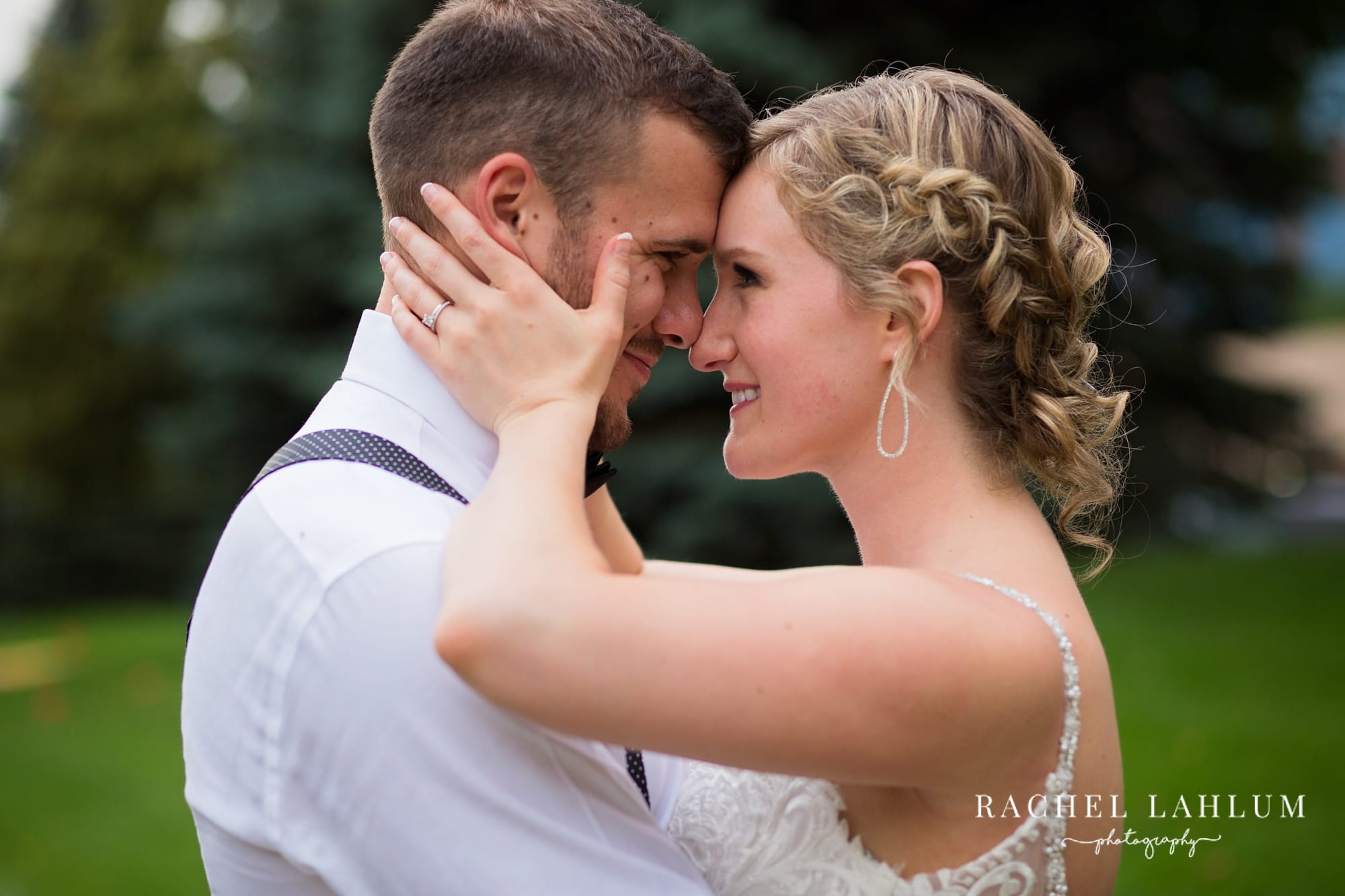 Portrait of bride and groom staring into each other's eyes at Golden Valley, Minnesota, wedding.