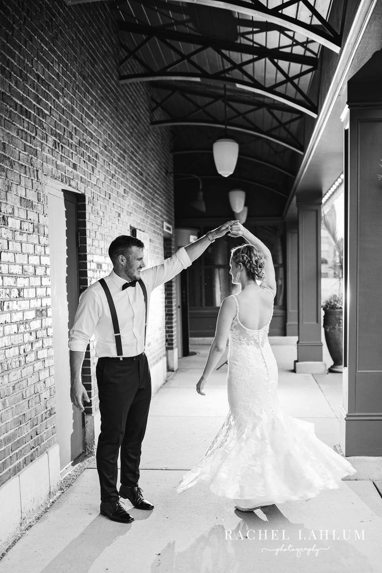 Groom twirls bride at the Metropolitan Club & Ballroom in Golden Valley.