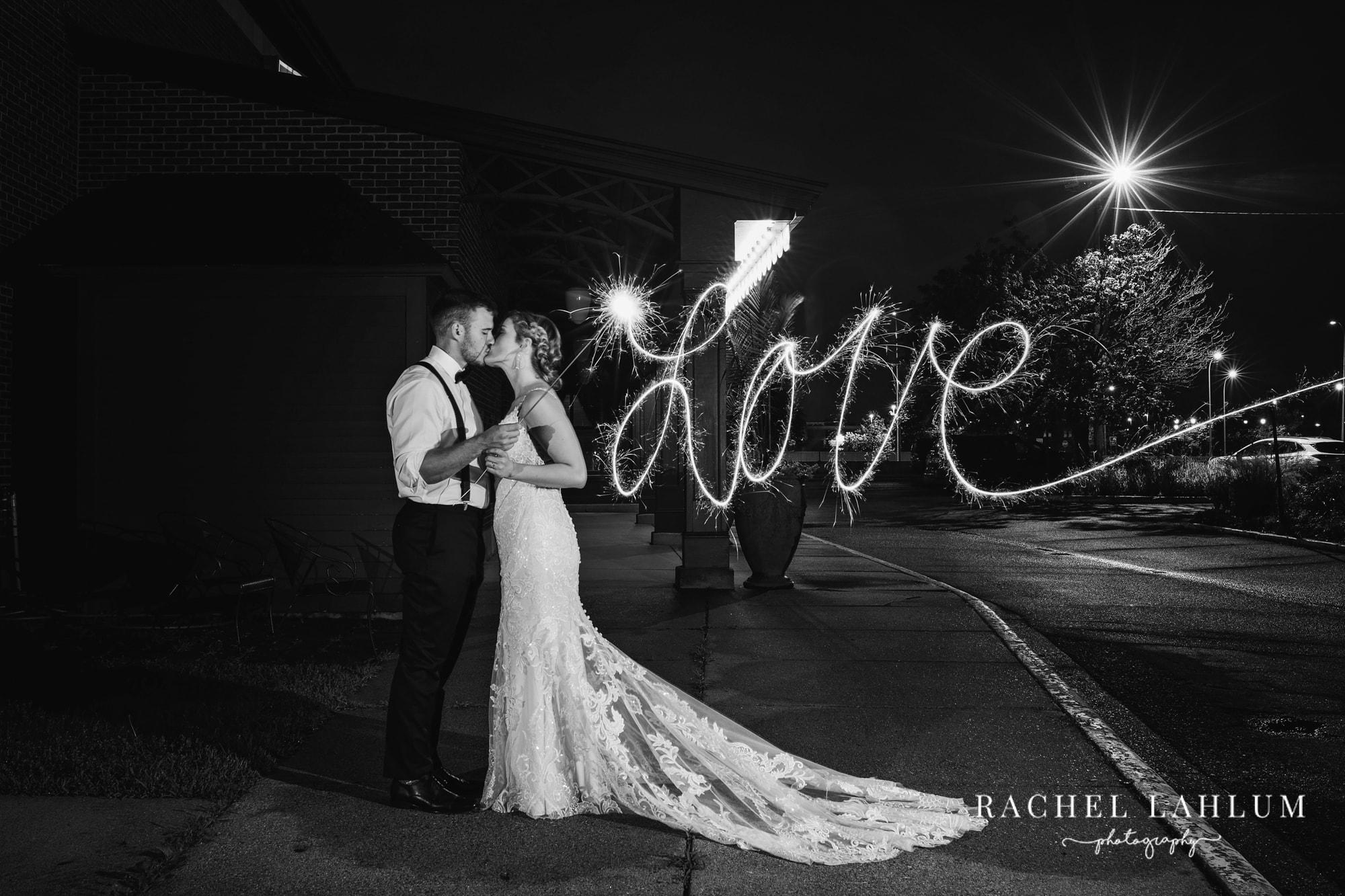 Alyssa and Landon kiss outside of the Metropolitan Club in Golden Valley, Minnesota.