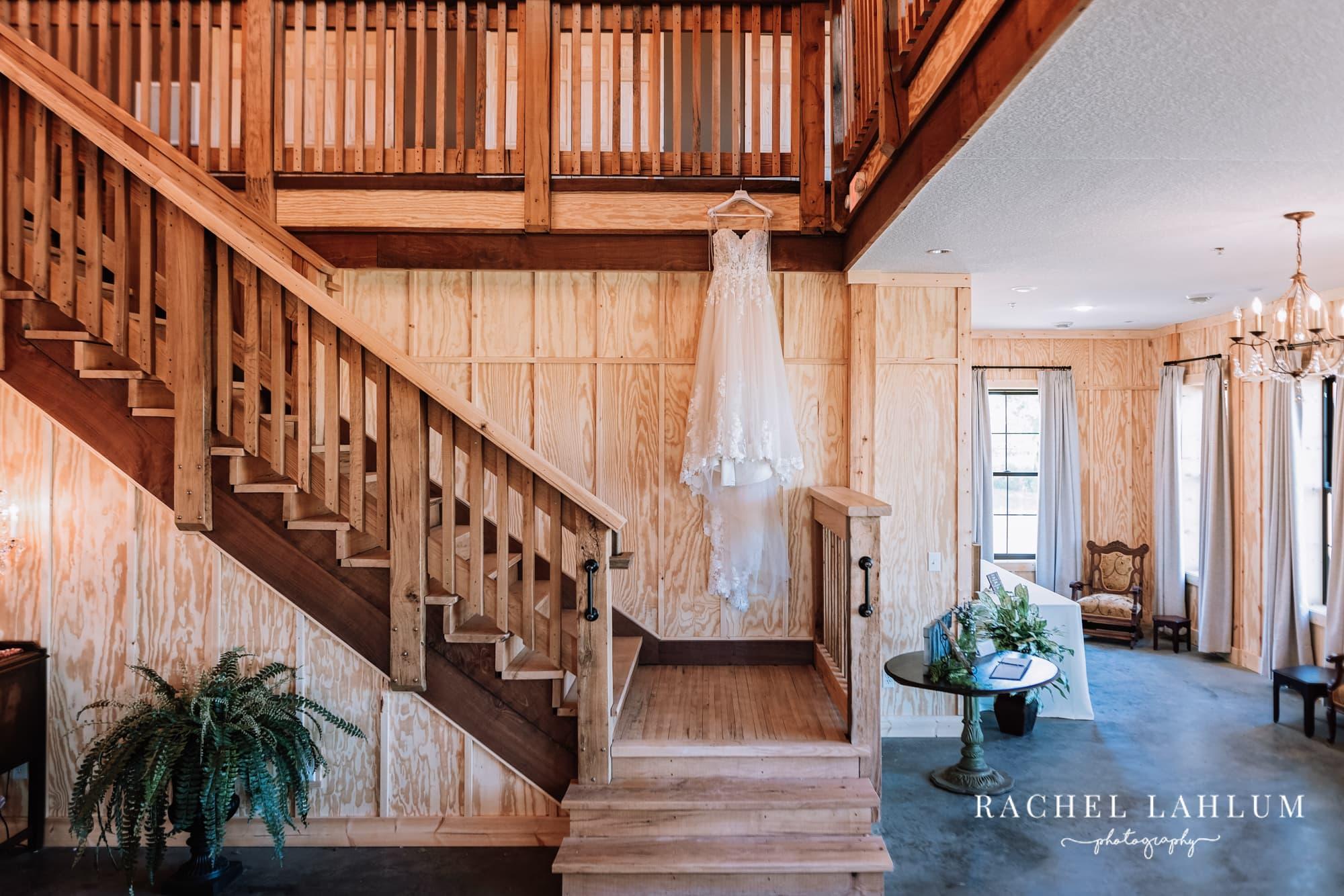 Wedding dress hangs from balcony at Circle B Ranch in Isanti, Minnesota.