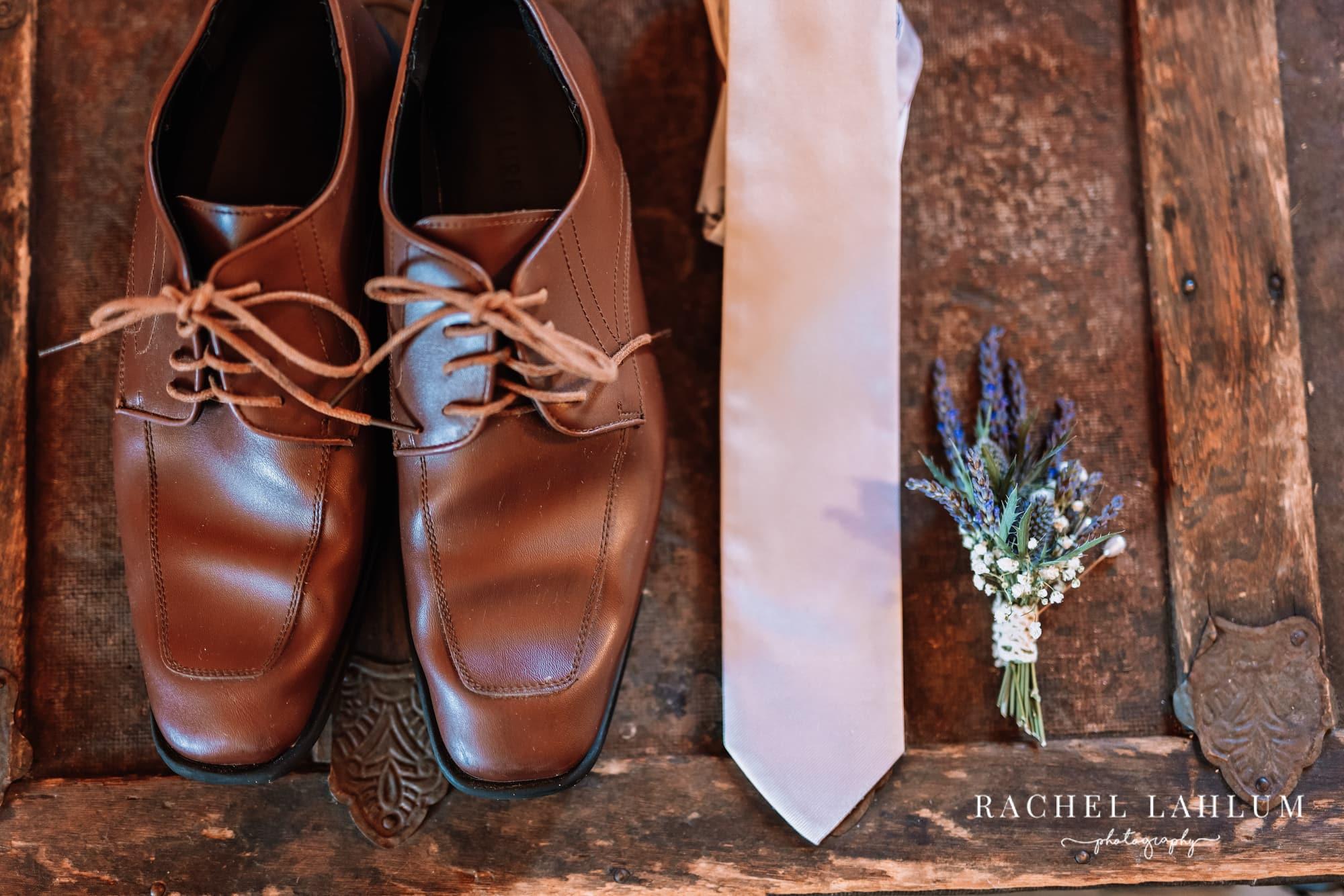 Groom's accessories at styled shoot at Circle B Ranch.