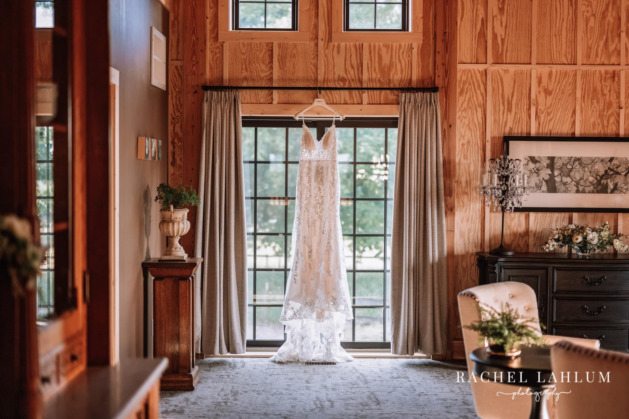 Dress hangs from curtains inside bridal suite at Circle B Ranch in Isanti, Minnesota.
