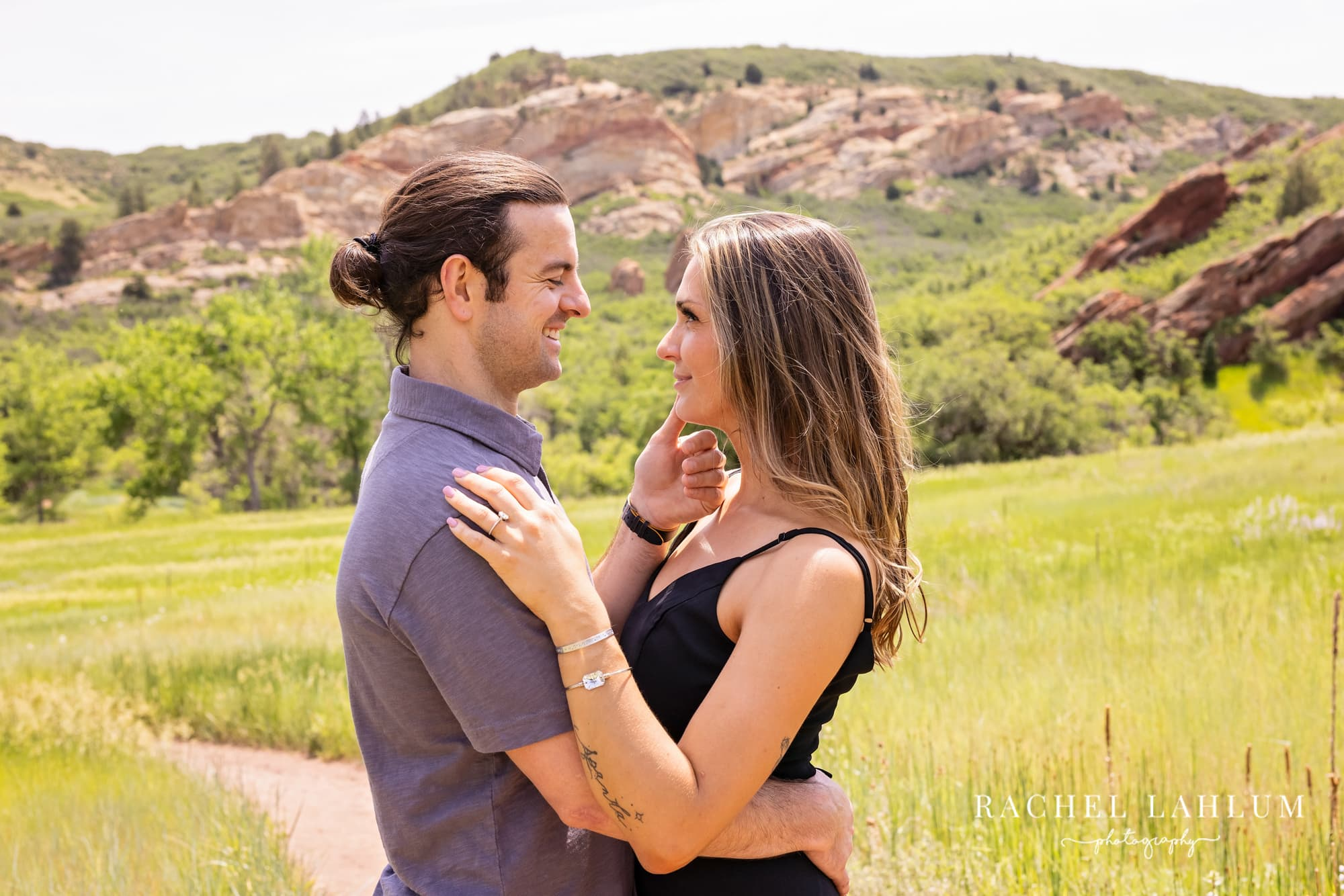 Makayla and Matt look into each other's eyes during their engagement session at Roxborough State Park.