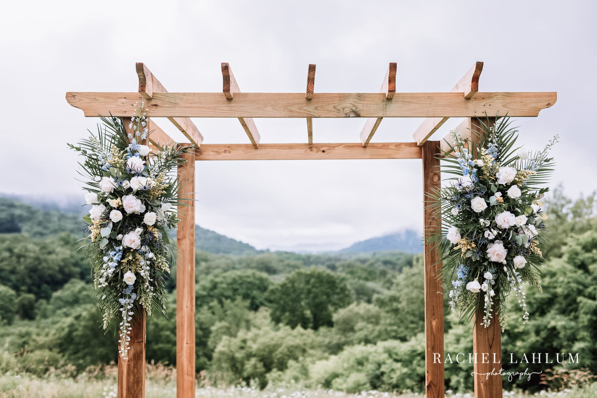 Decorations hang from the wedding arch outside Cedar Creek Barn in Winona, Minnesota.