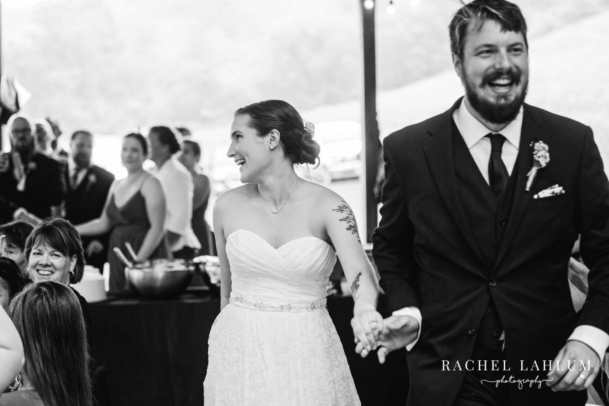Bride and groom enter the reception at Cedar Creek Barn.