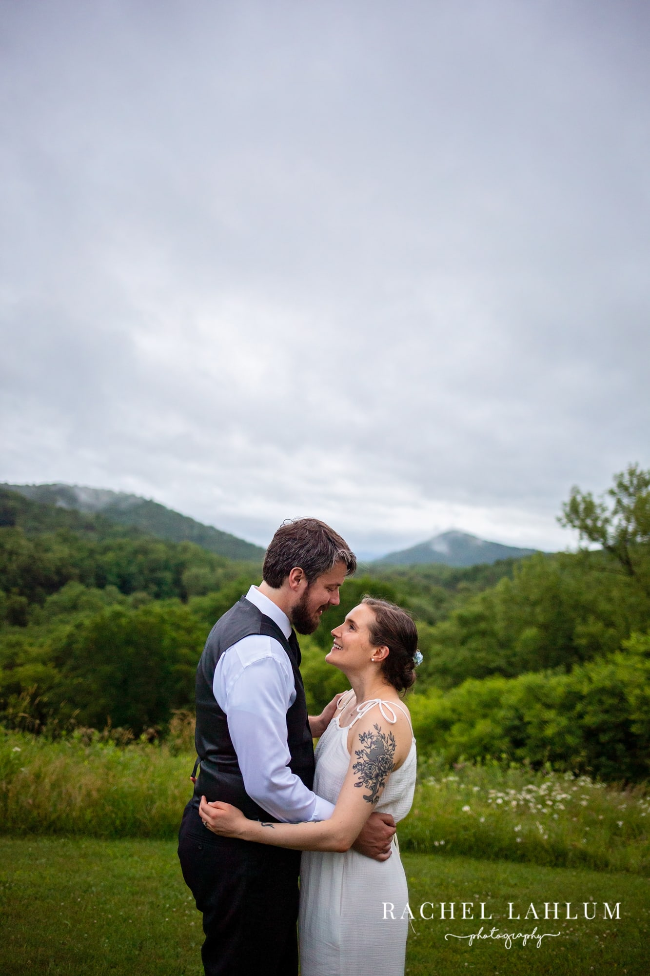 Bride and groom hold each other overlooking the hills of Winona, Minnesota.