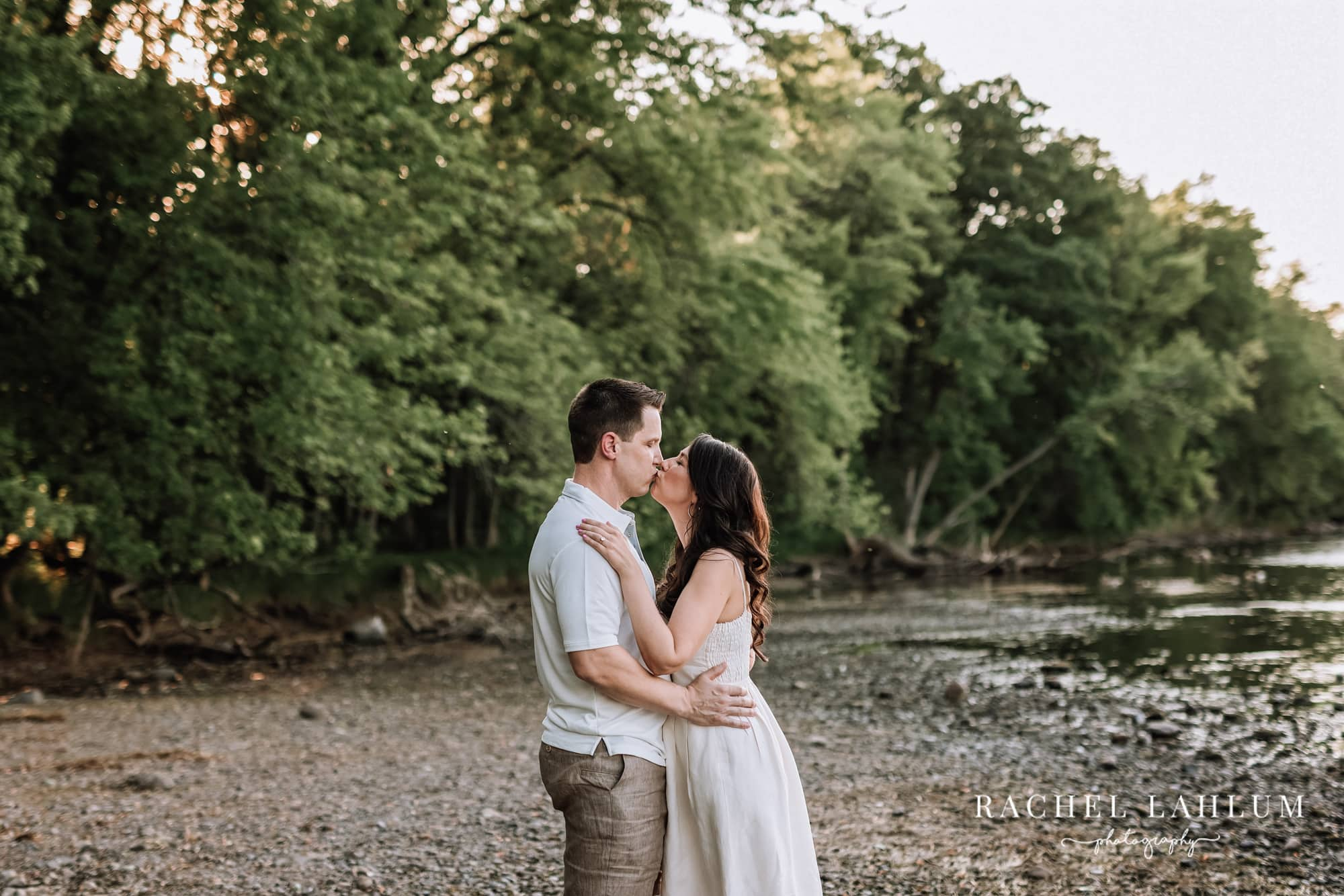 Couple kiss during engagement photography session at Montissippi Park.
