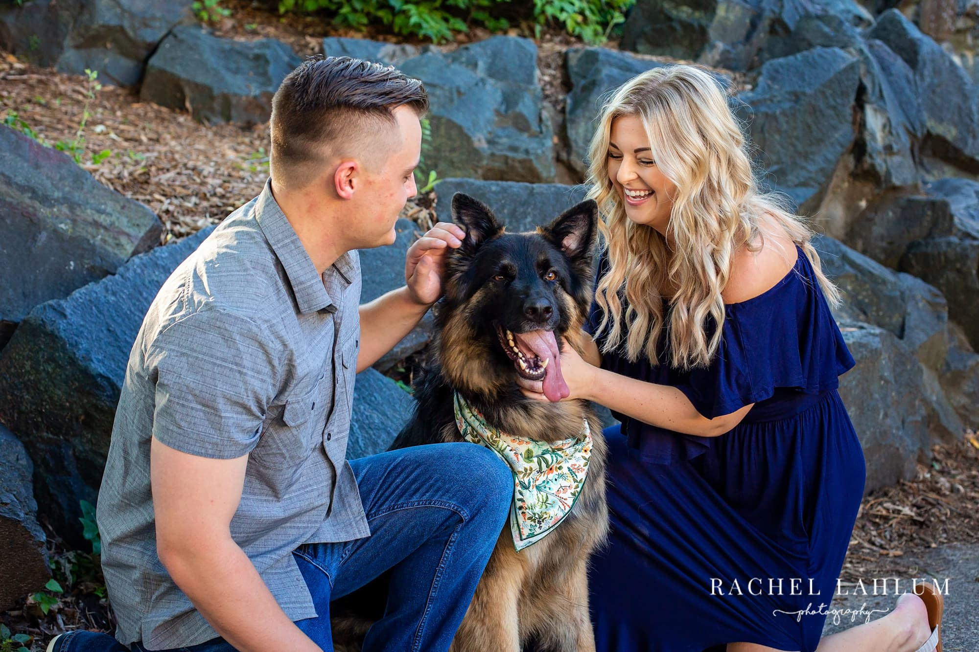 Engaged couple pet their dog during an engagement photo session at Como Park.