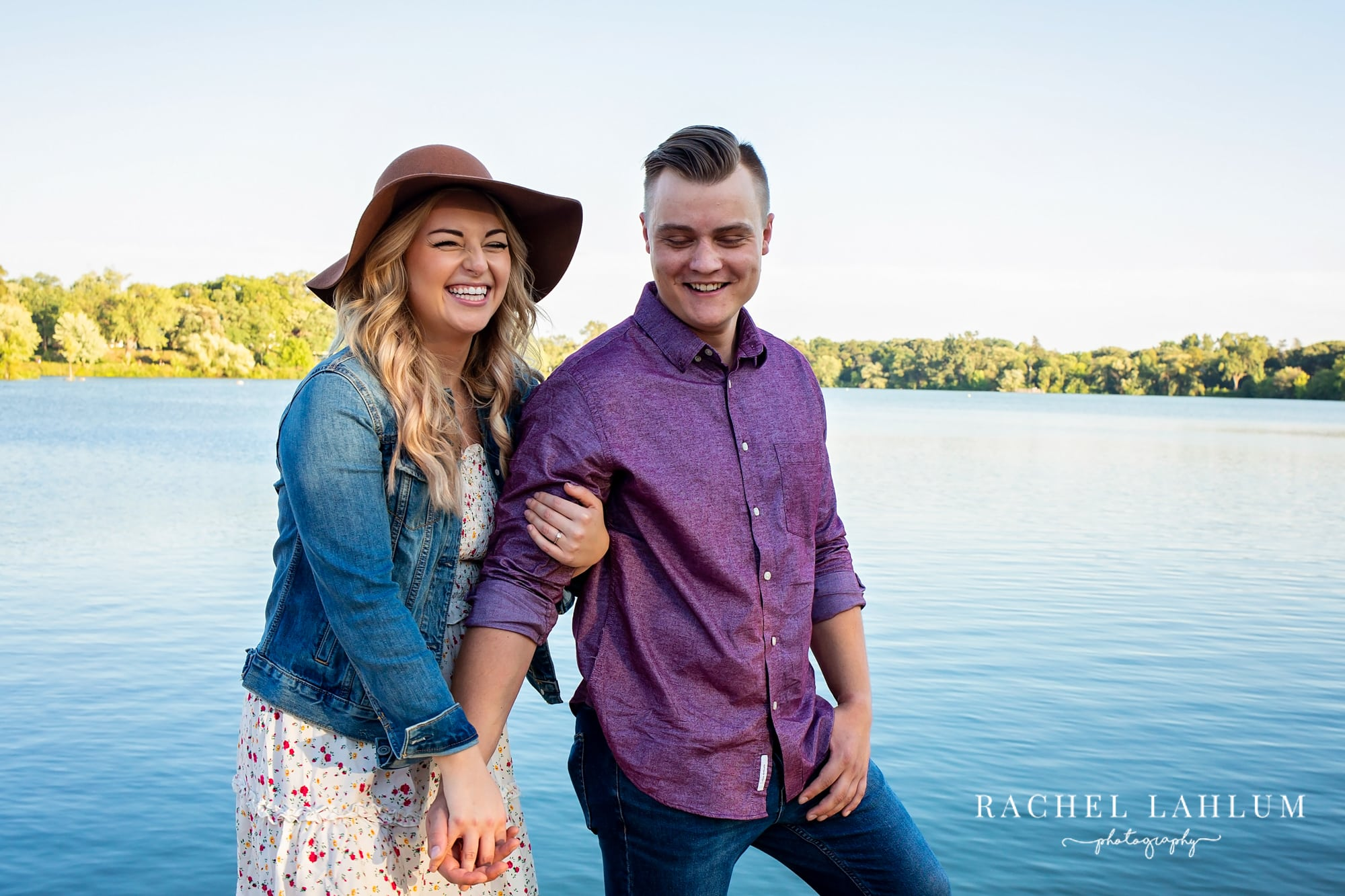 Engaged couple hold hands during engagement photo session at Como Lake in St. Paul, Minnesota.