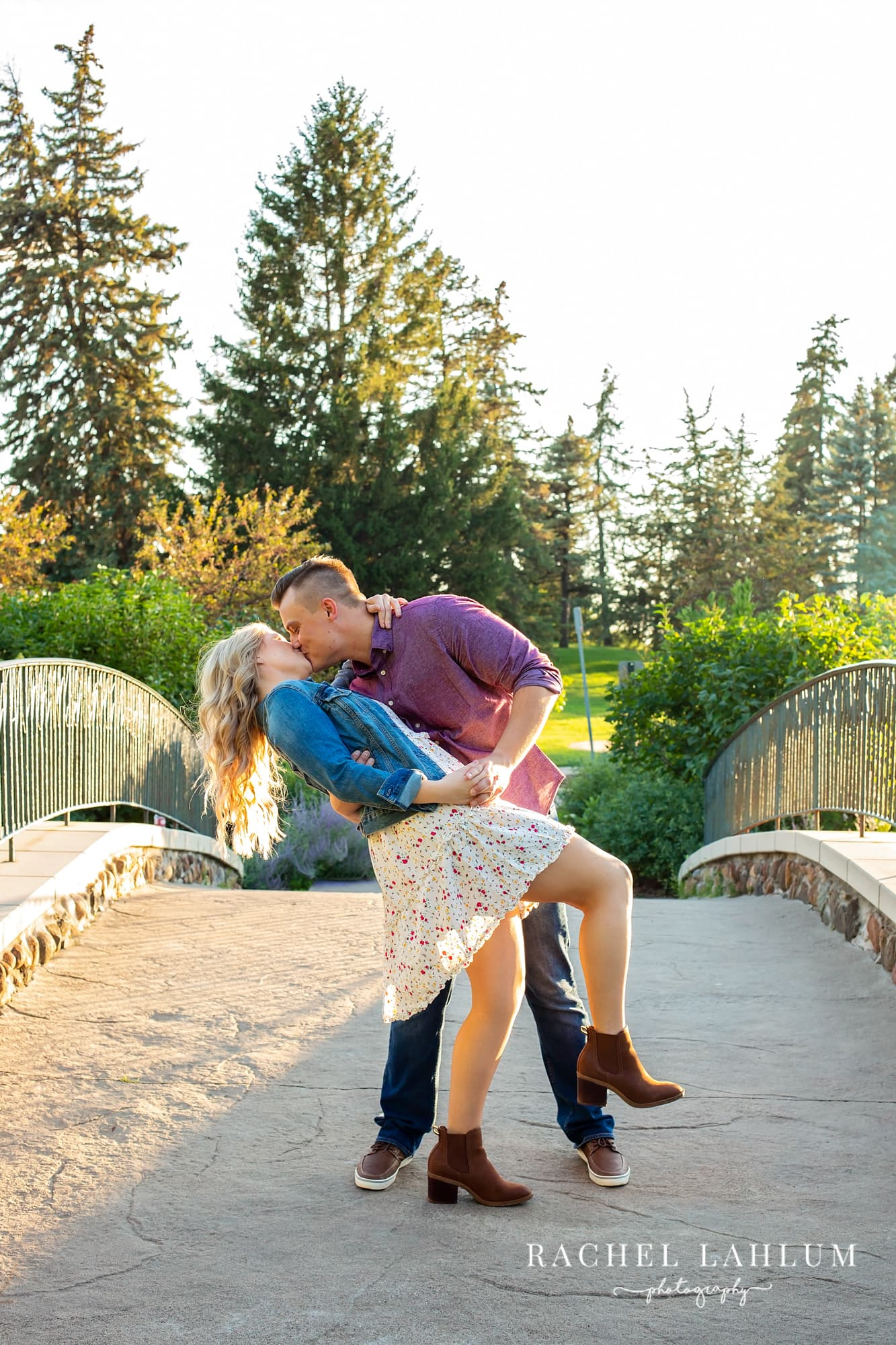 Tyler dips Emily on bridge during engagement photo session at Como Park in St. Paul.