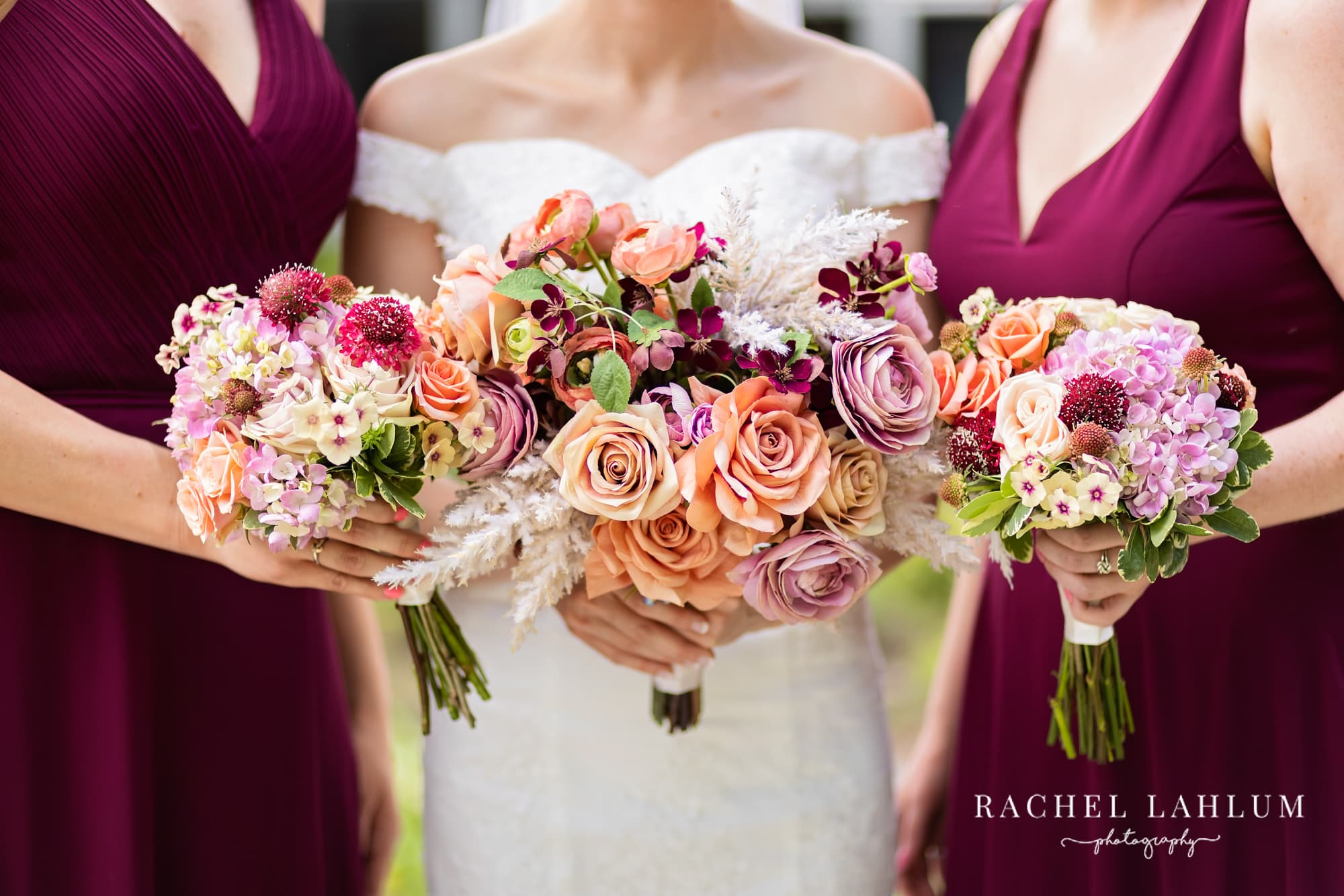 Bride and bridesmaids hold bouquets for a close up at St. Anne's Episcopal.