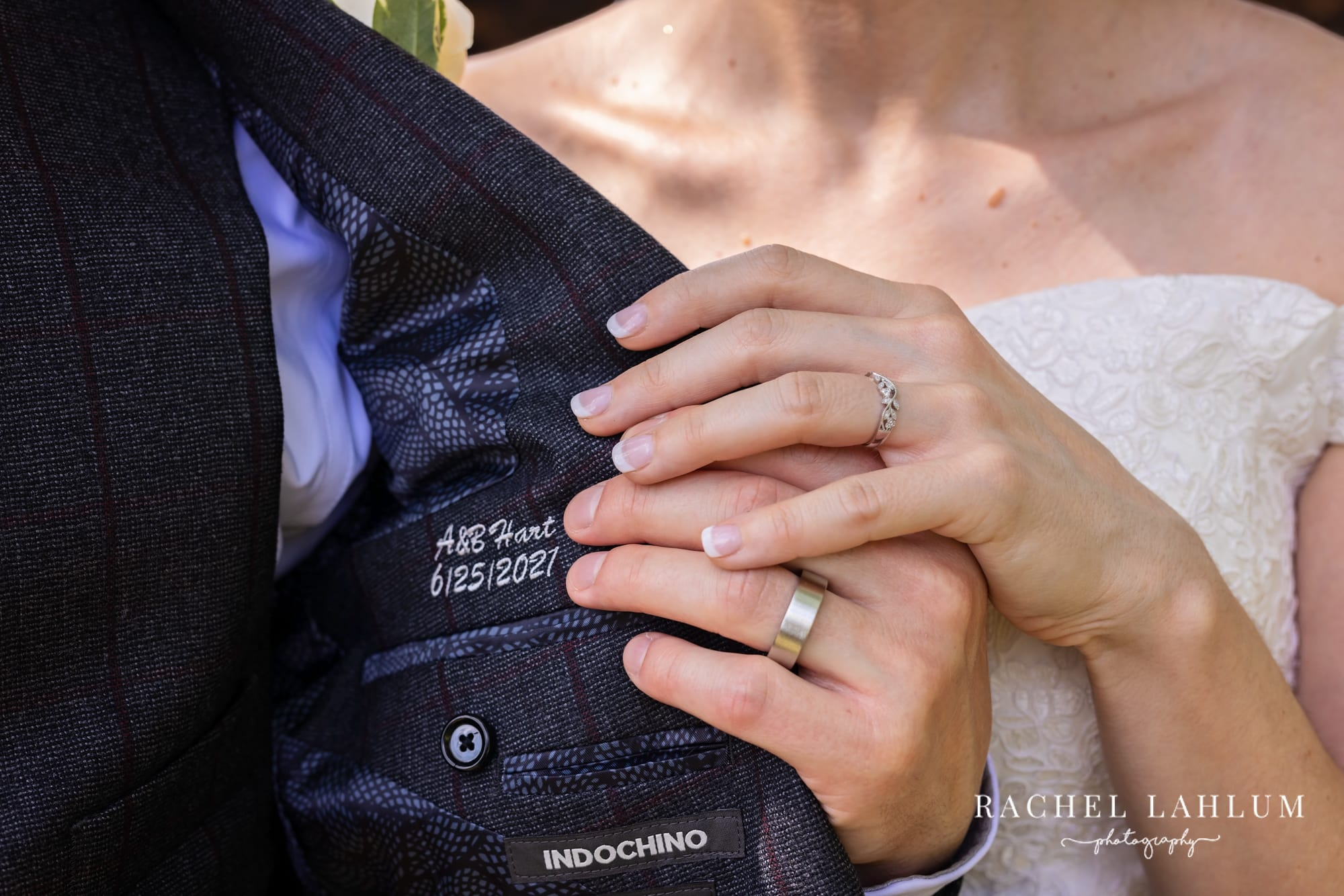Bride and groom show off wedding bands after St. Paul wedding ceremony.