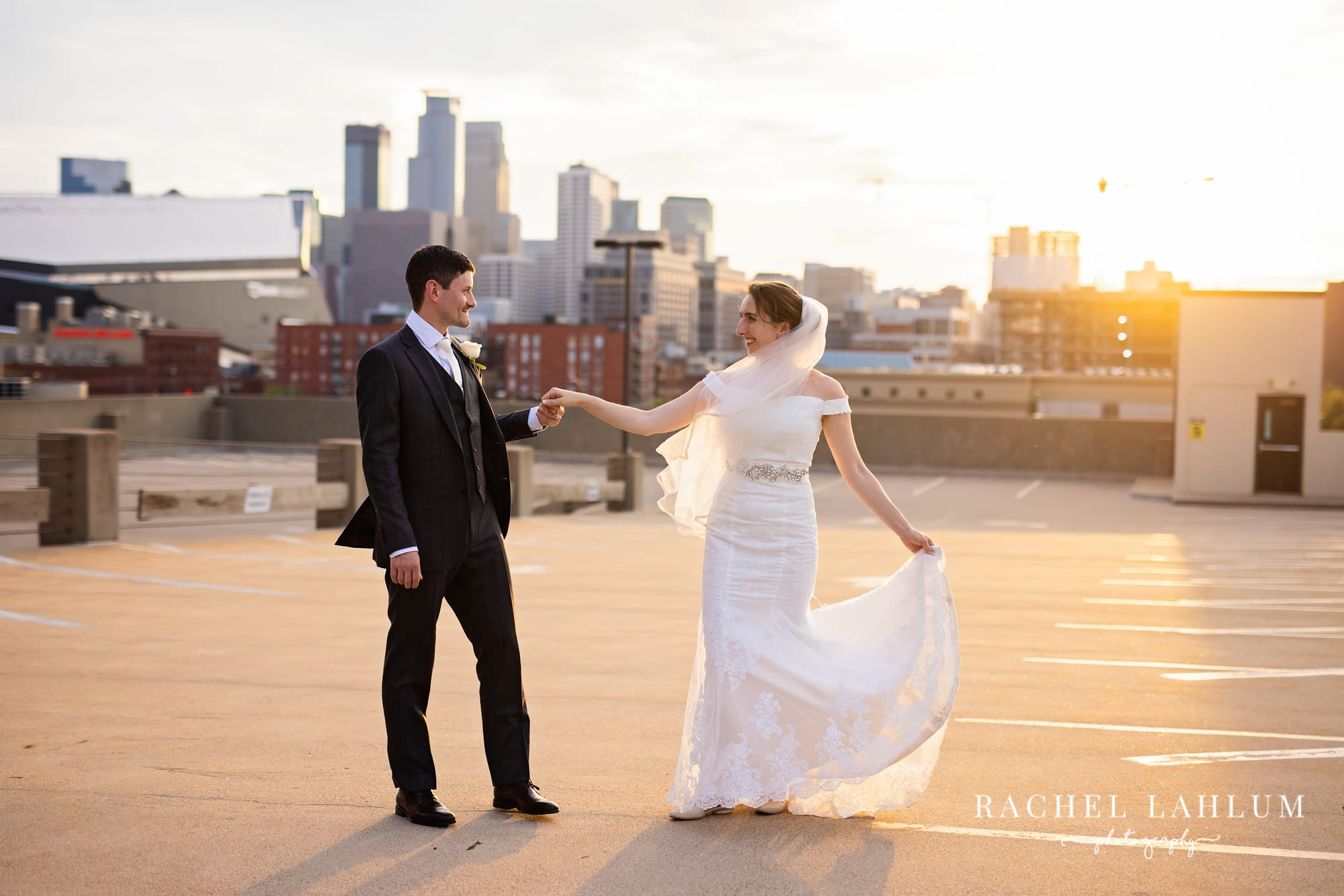 Newly-wed couple pose on rooftop at sunset during wedding reception in Minneapolis.