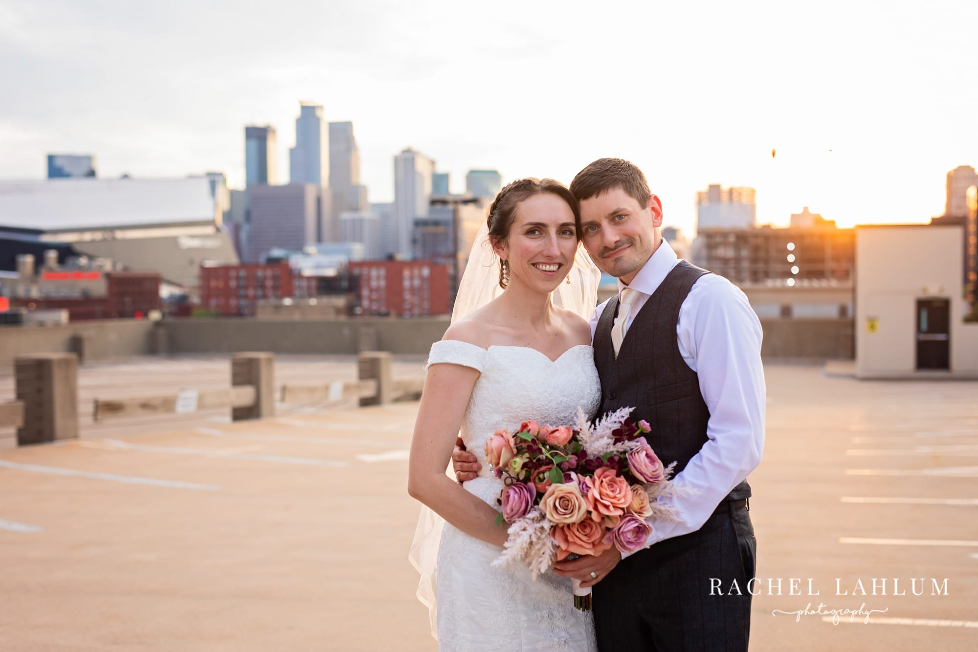 Newly weds pose for a portrait on a Minneapolis Rooftop.