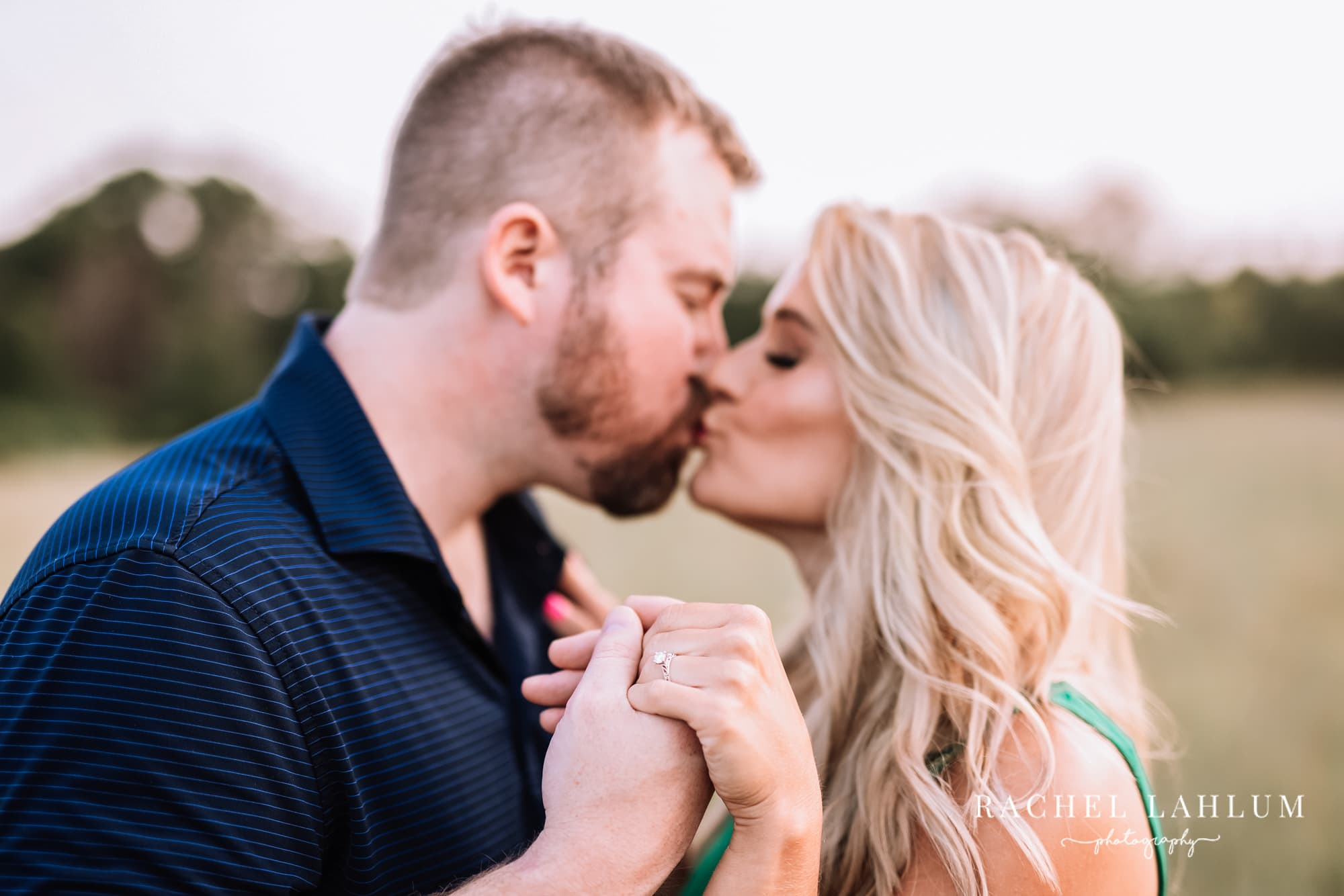 Engaged couple kiss during engagement photography session in North Branch, Minnesota.